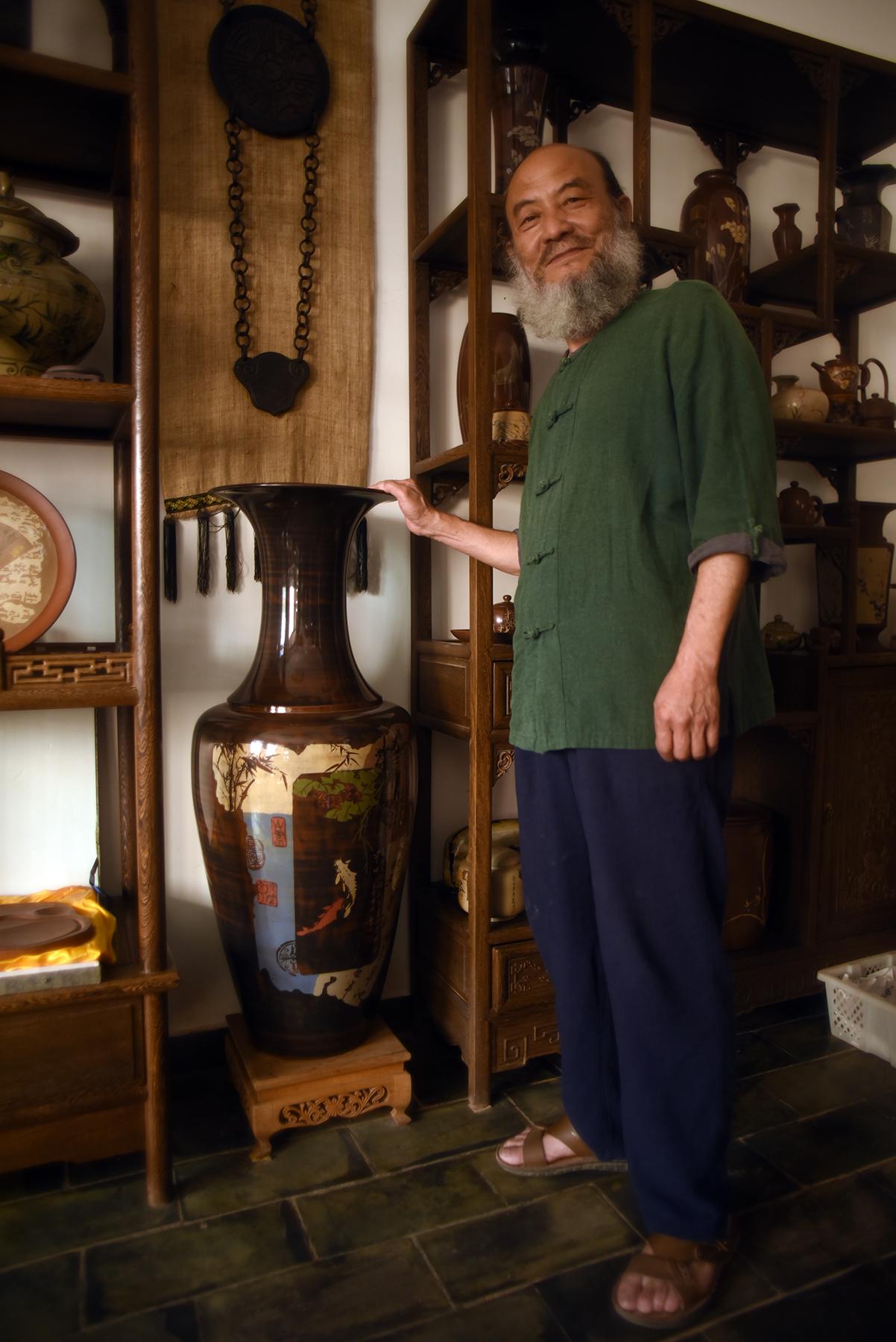 Tan Zhi Fan,Inheritor of Purple Pottery Intangible Cultural Heritage, Jianshui, Yunnan Province.