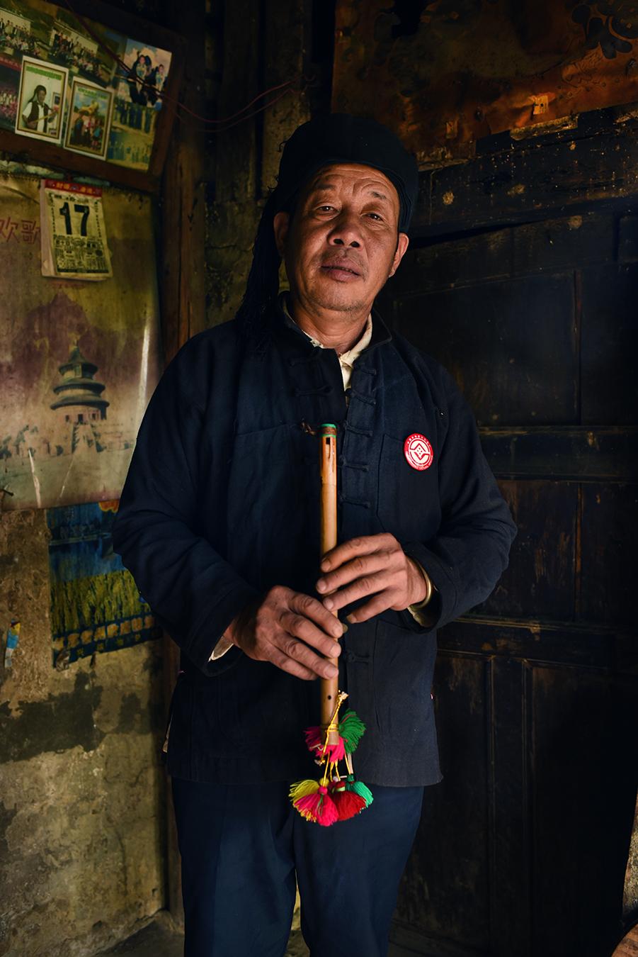 Inheritor Chen Eduo with his  Ba Wu  wind instrument.  Puchun village, Yunnan 2017.