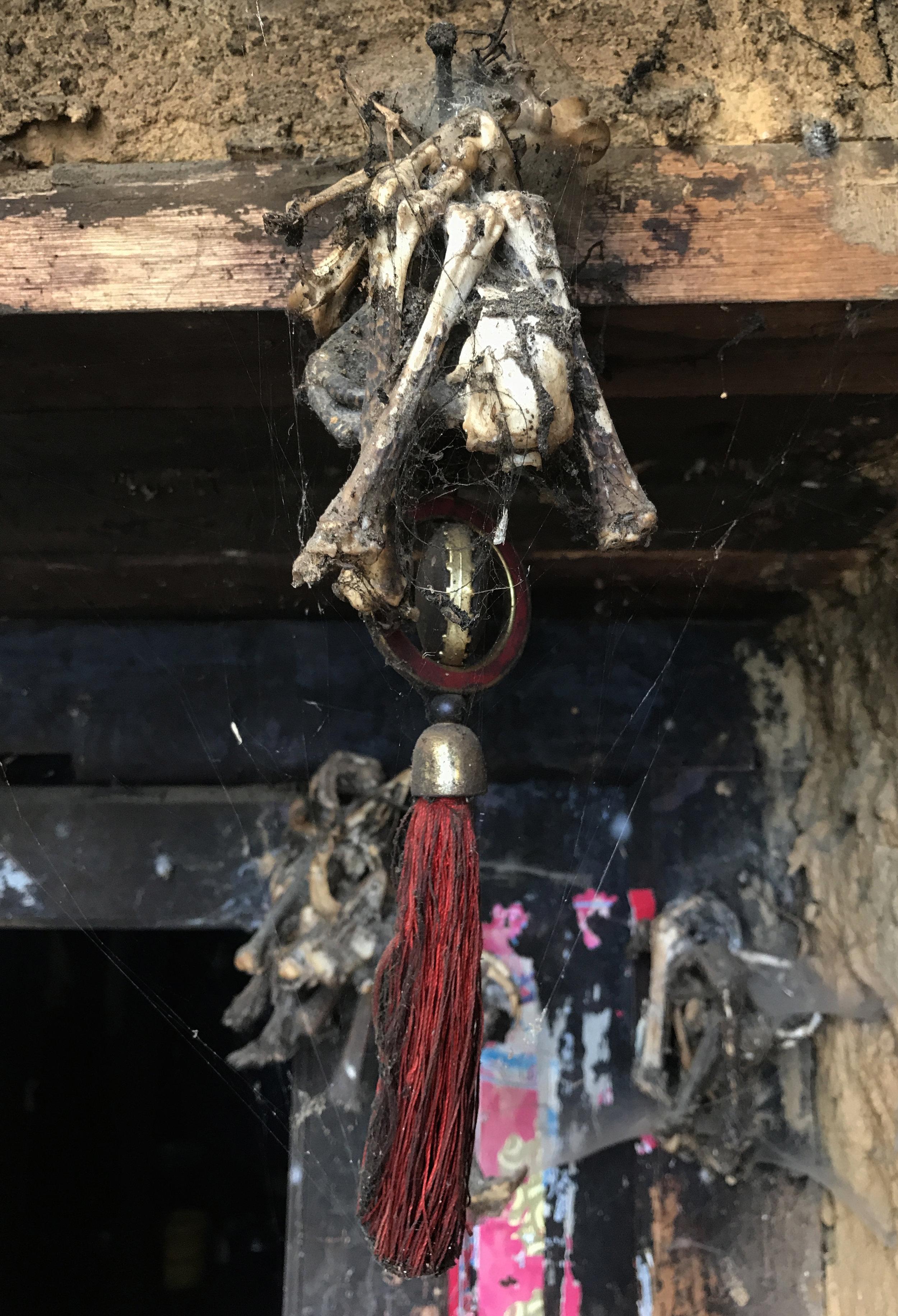 Bones and tassels, Luomo village.