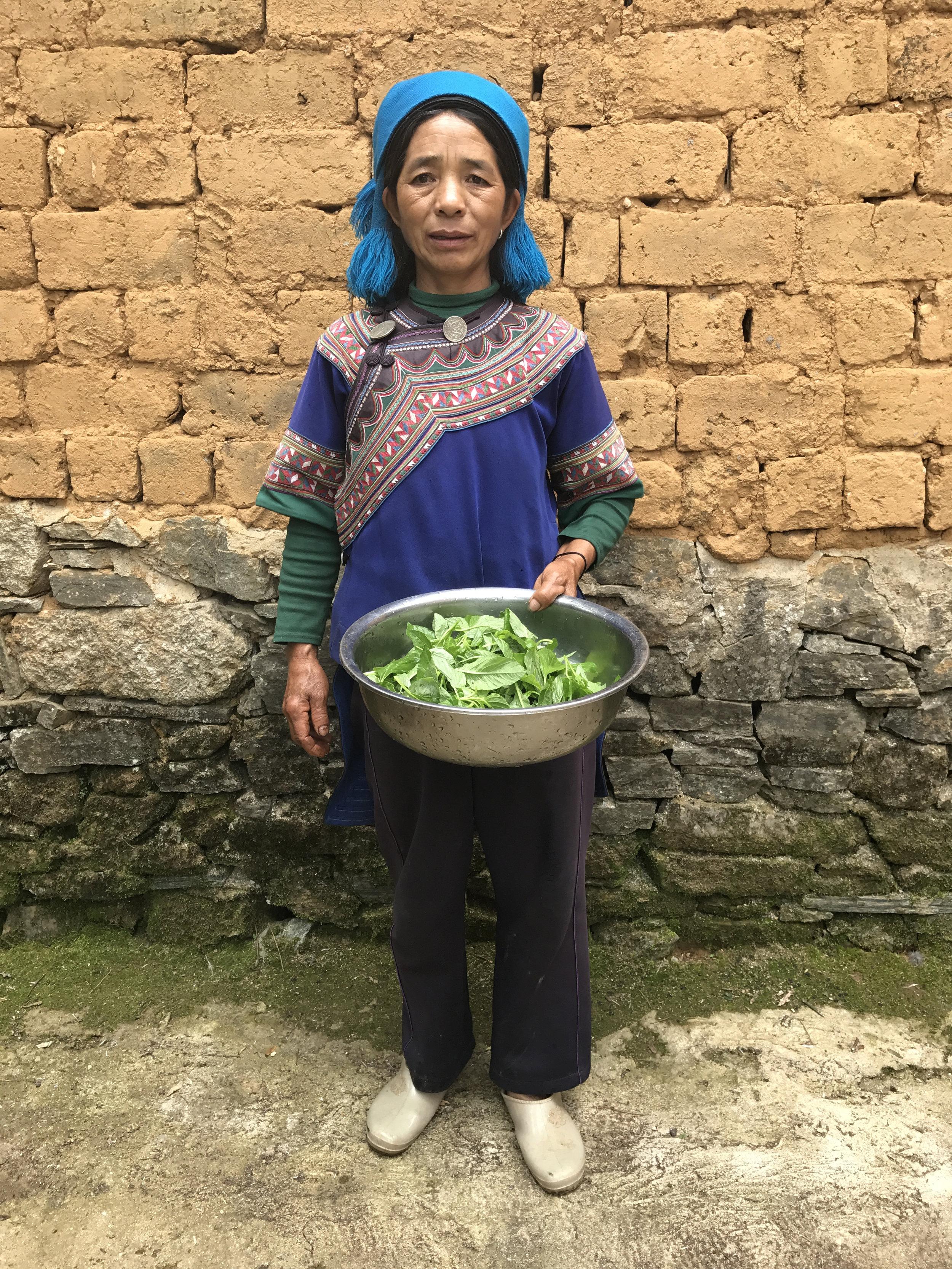 Hani woman preparing lunch, Luomo village, 2017.