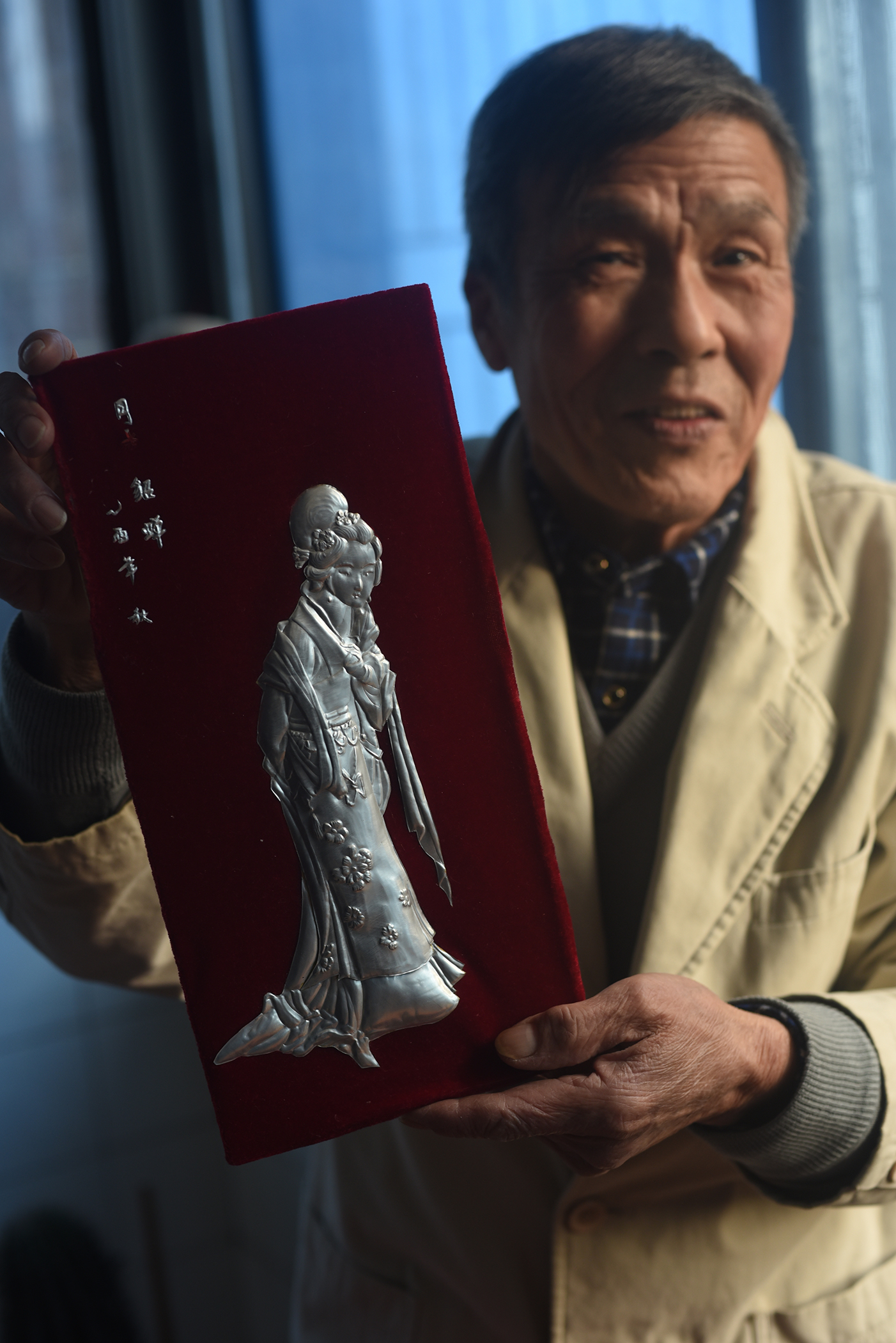 Wang Hualin, Inheritor of Intangible Culture Heritage, metalwork and egg sculpture, Jingzhou