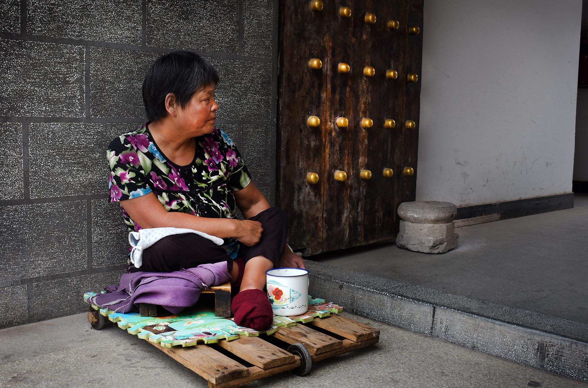 Beggar at the gate