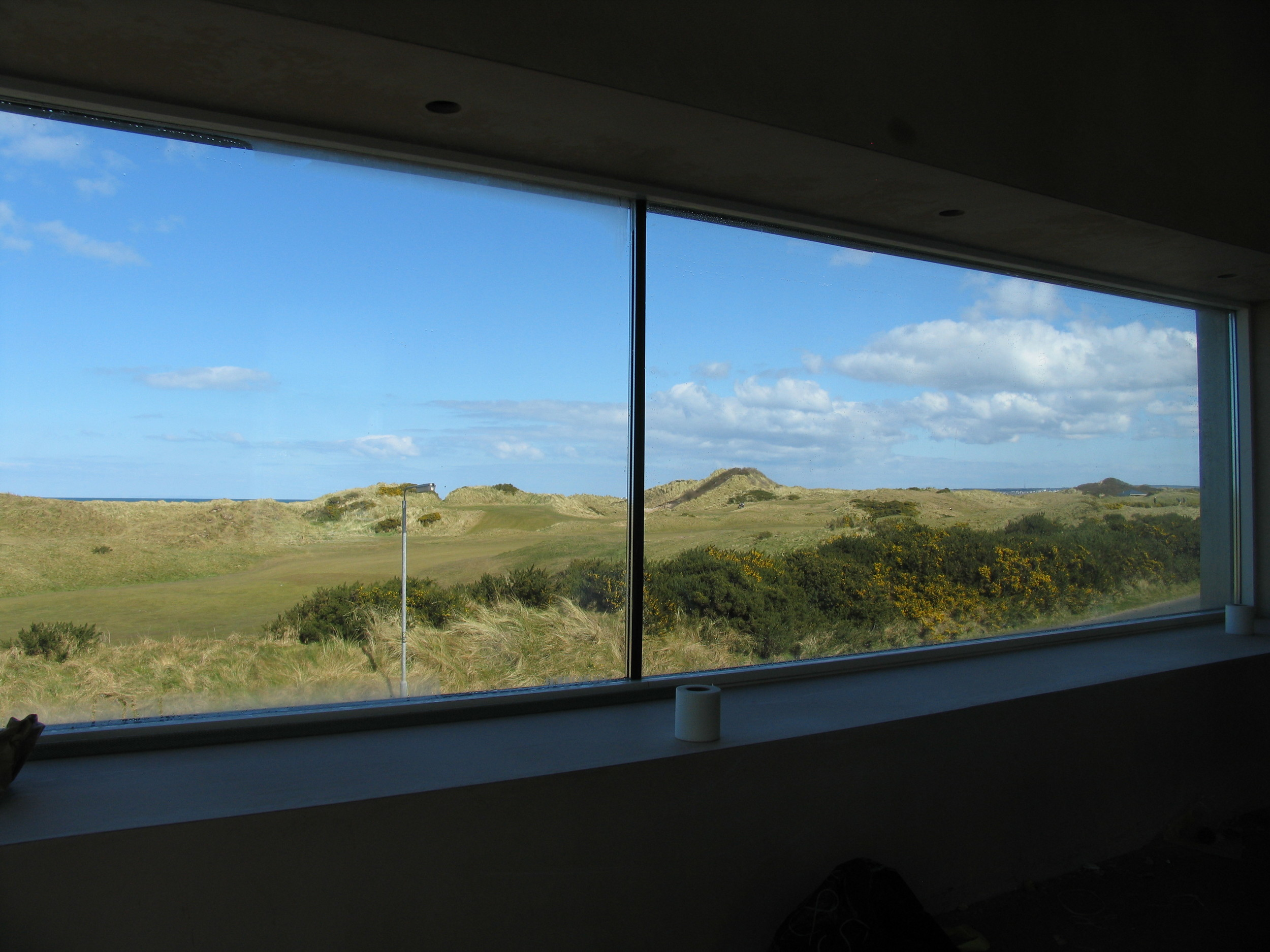 view from the lounge picture window overlooking the first hole at castlerock championship golf course