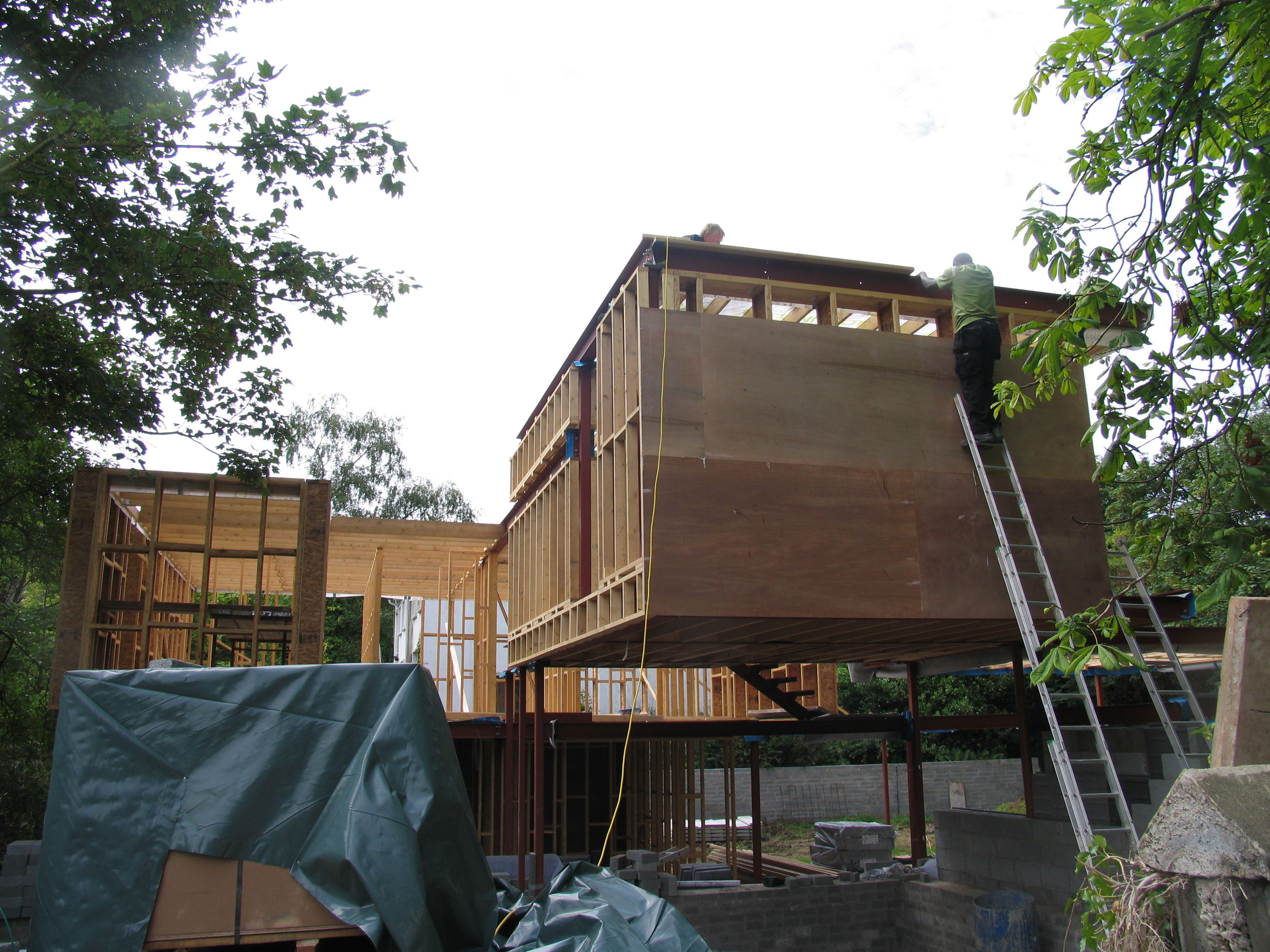 cantilevered box being plywooded