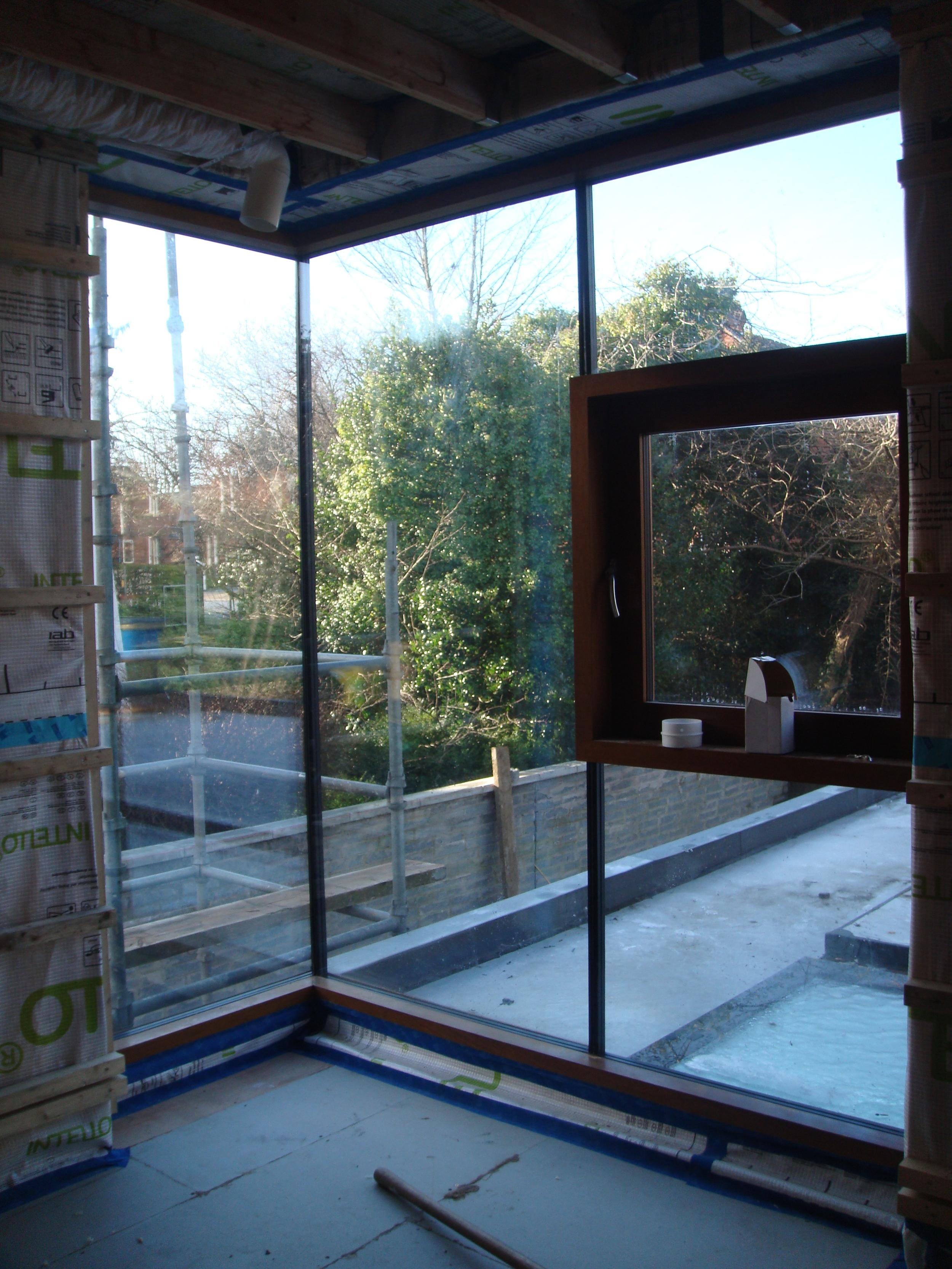 frameless glazed corner window