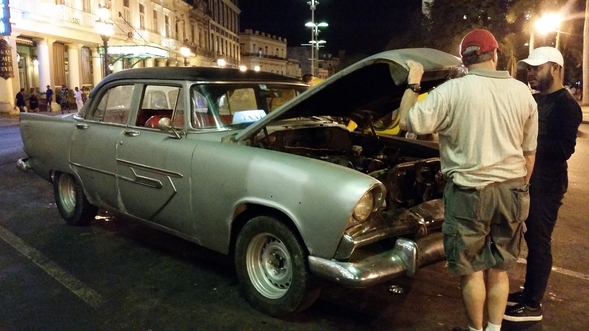 My dad chatting with a taxi driver while we explore Old Havana at night.