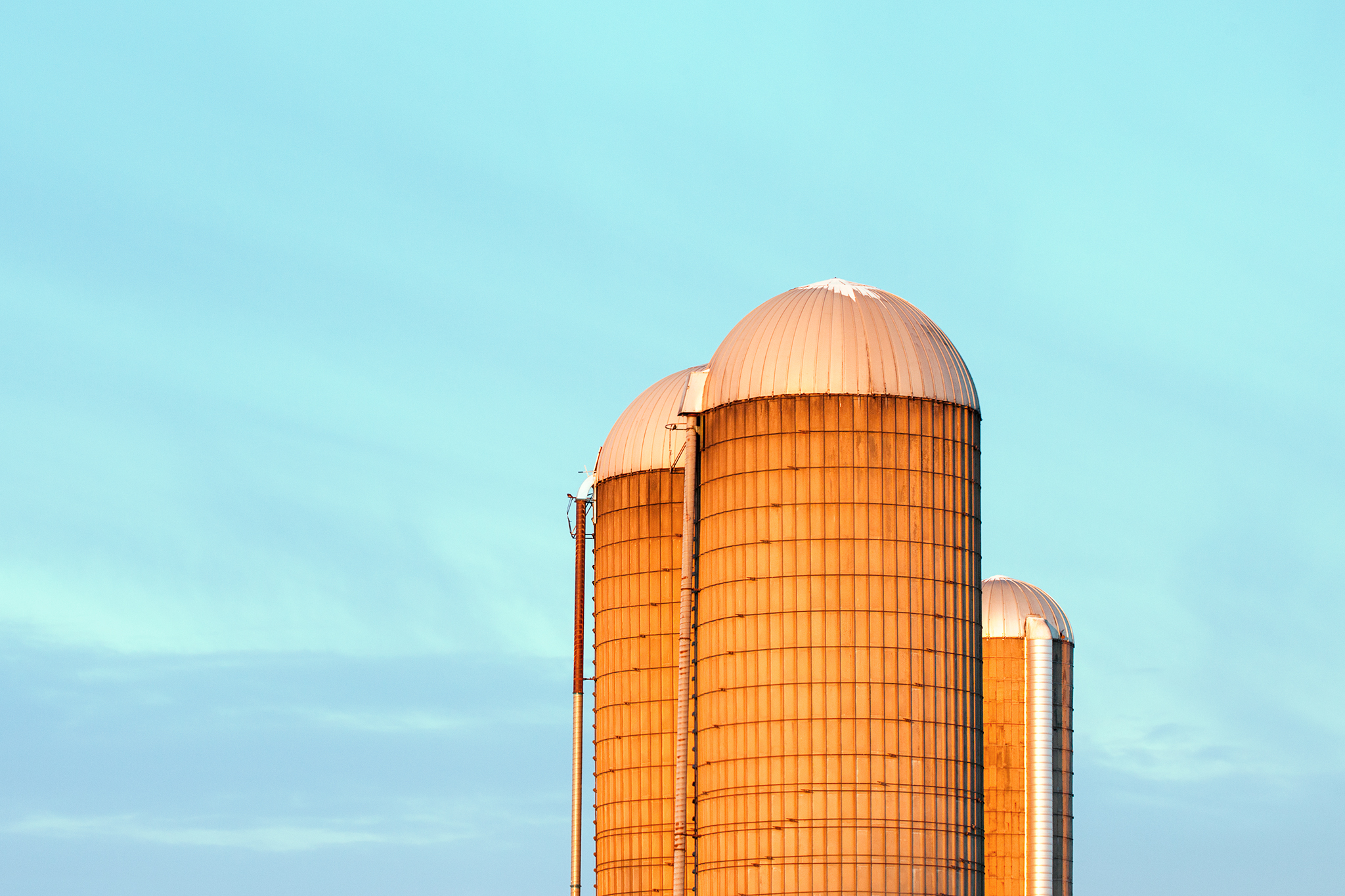 A trio of farm silo illuminated by the morning light somewhere near Mount Horeb, Wisconsin .   → Buy a Print