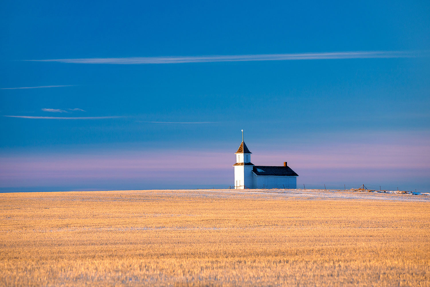 A small, rural church (no longer in use) sits high atop the Montana plains north of Dunkirk.  → Buy This Print