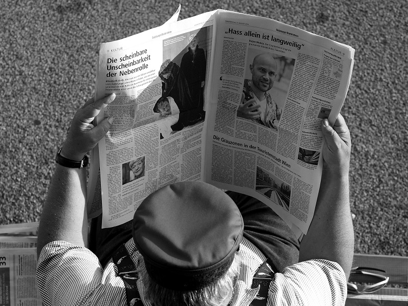 A man reads a newspaper on the streets of Salzburg, Germany. Photo by  Thomas Geiregger .