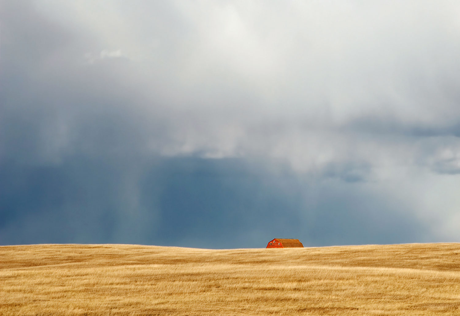 A storm looms large over the horizon somewhere on the plains of South Dakota.  → Buy a Print