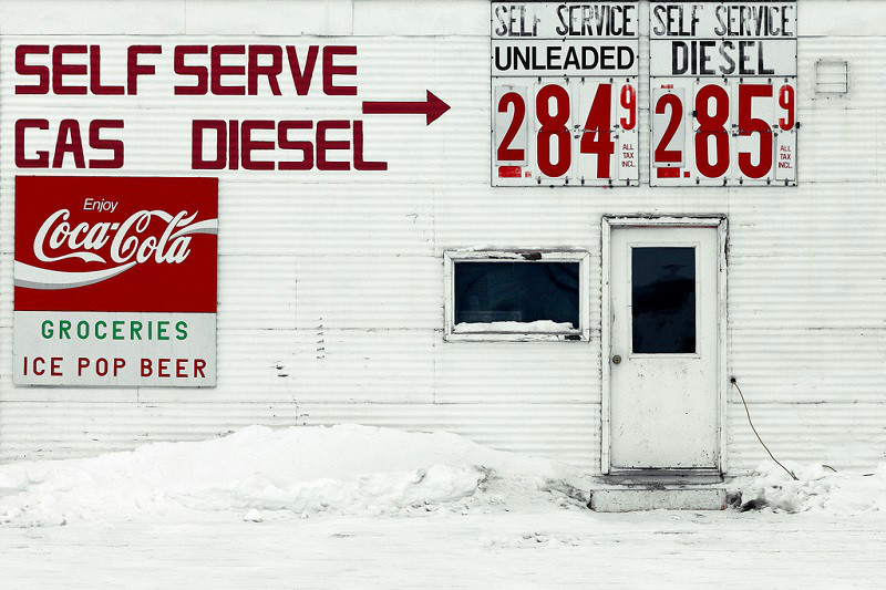 The side of a service station and small grocery store in the small town of Circle, Montana.    → License Photo