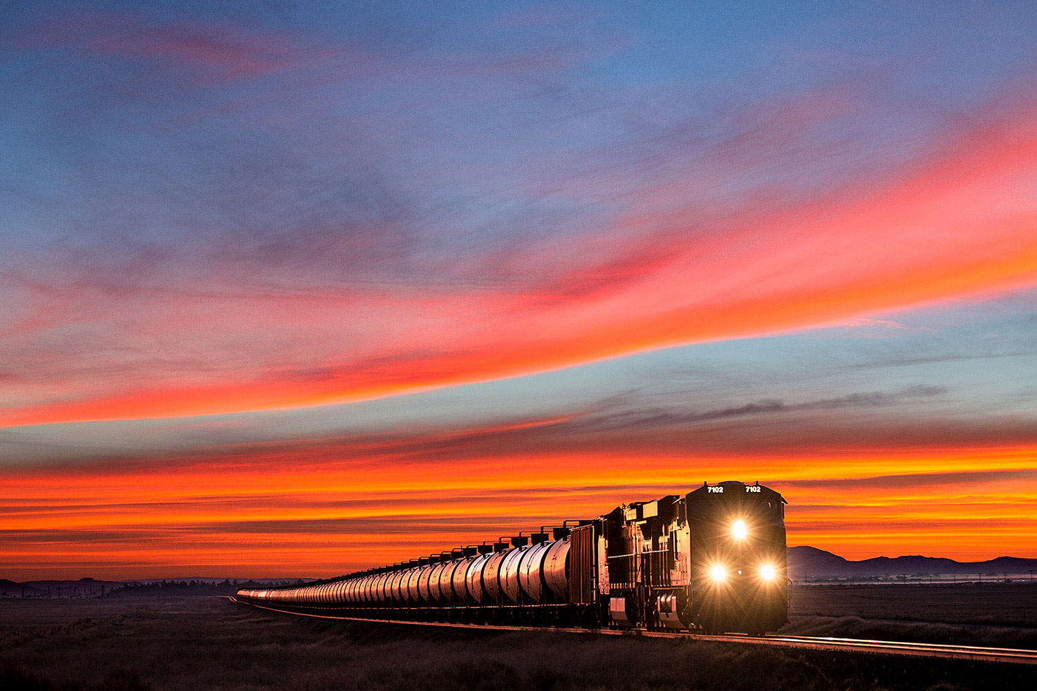 A BNSF train between Havre and Kremlin, Montana hauls oil from the Bakken oil fields west to be refined.     → Buy a Print