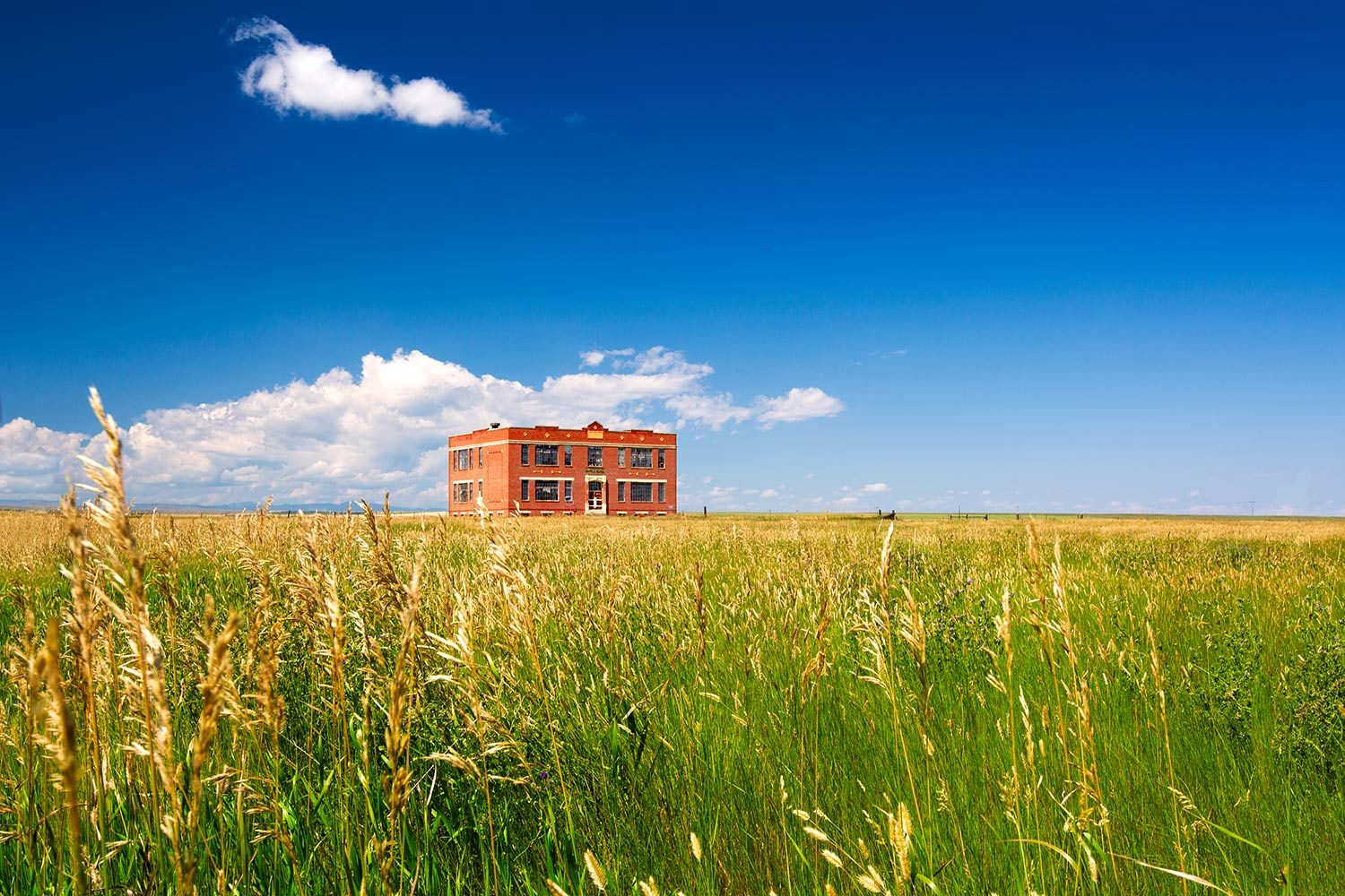 An old brick schoolhouse that has long been abandoned on the plains of what was downtown Buffalo, Montana.  → Buy This Print