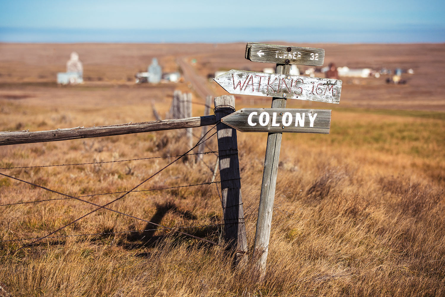 An old sign post stands alone on the quiet plains outside of Loring, Montana pointing the way to Turner, Watkins, and the Loring Hutterite Colony.   → Buy a Print
