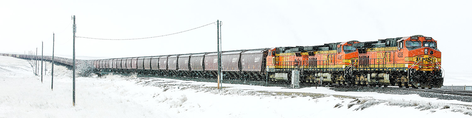 The 11:15 a.m. train from BNSF chugs on through snow on its way to its destination.   → Buy a Print