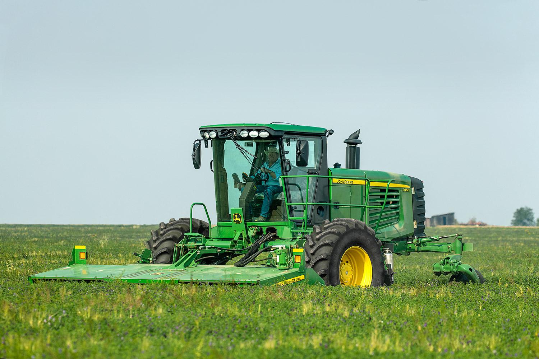 A farmer cuts alfalfa on a farm west of Valier, Montana.   → Buy a Print or  License Photo
