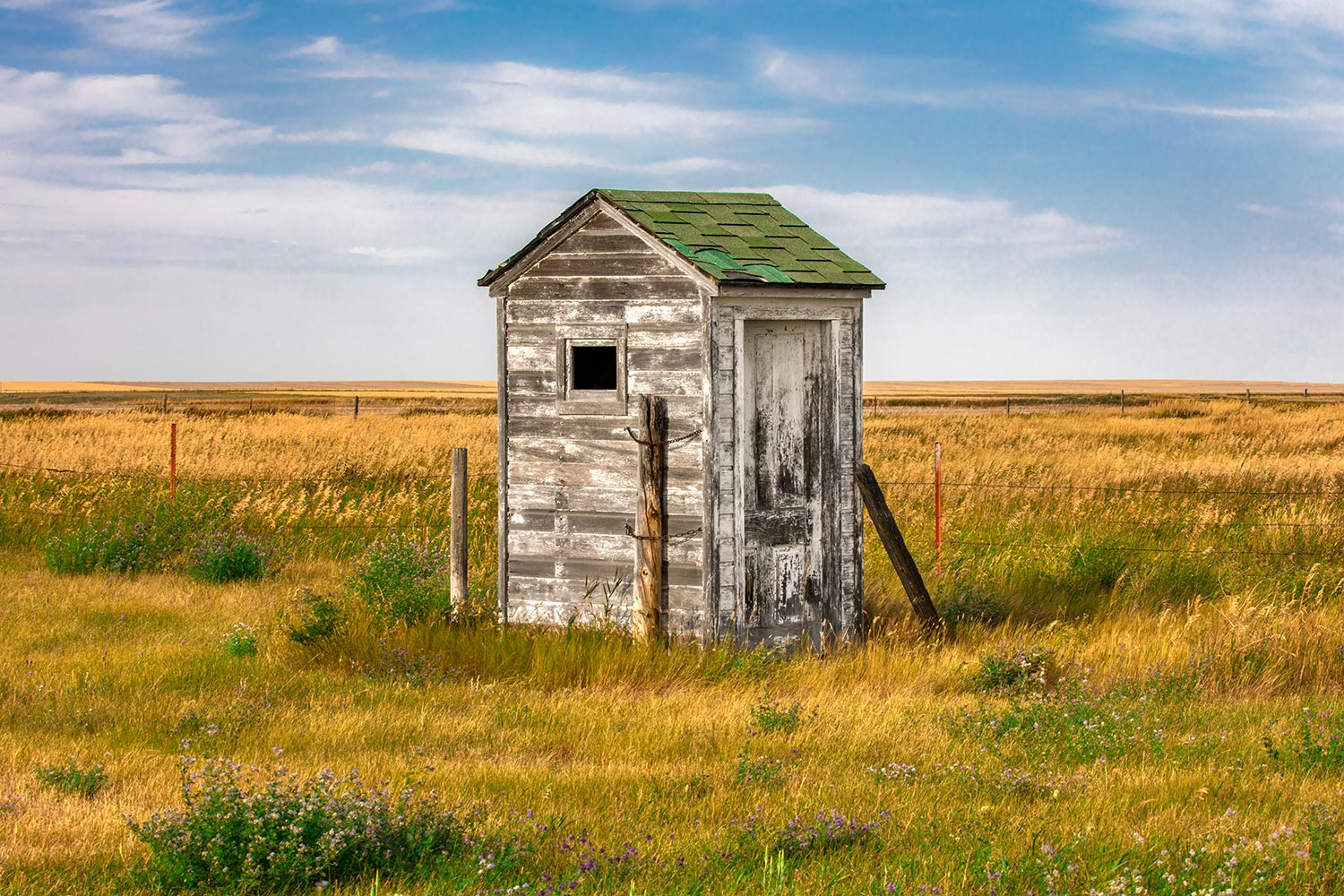 An old forgotten outhouse sits near the school in Pendroy, Montana.     → Buy a Print   or   License Photo
