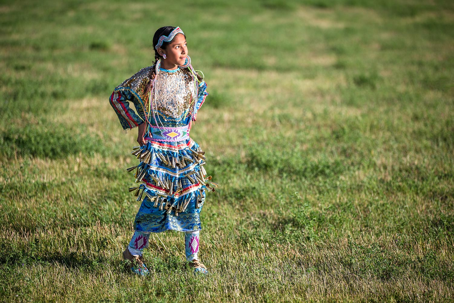 A native American jingle dancer at a pow-wow at Fort Belknap Indian Reservation.   → License Photo