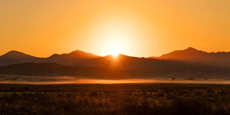 The sun rises over the Big Belt Mountains near Helena, Montana.