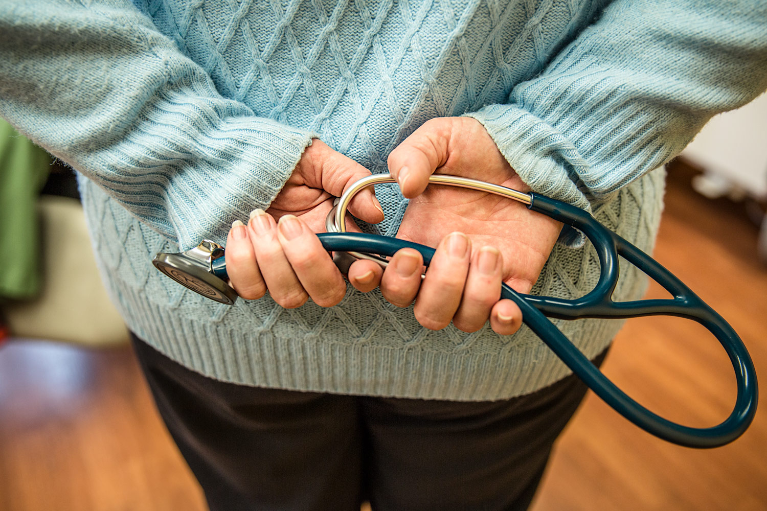 A doctor holds a stethoscope behind her back at a clinic in Havre, Montana.