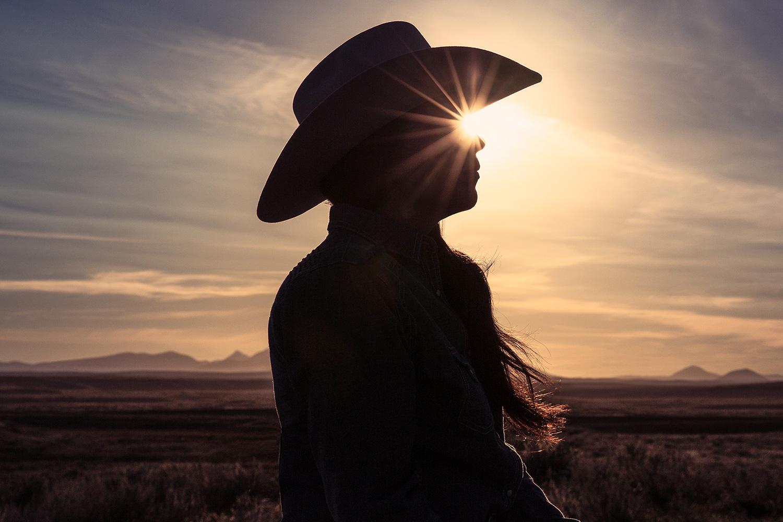 The sun shining through a cowgirl's eyes on a ranch near Fort Belknap, Montana.