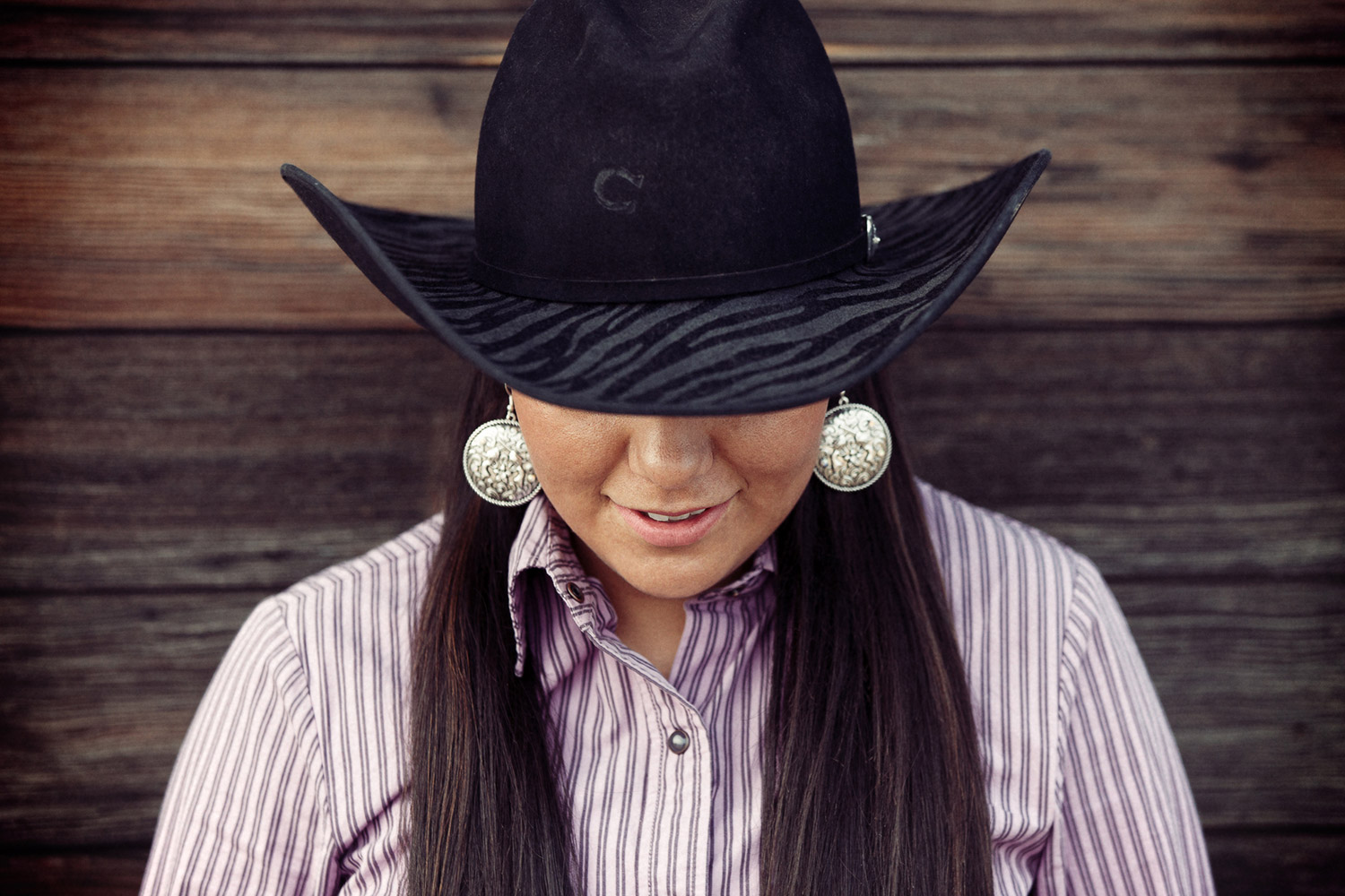 More cowgirl photos; this one is of a member of the MSU-Northern rodeo team poses for me outside of Havre, Montana.