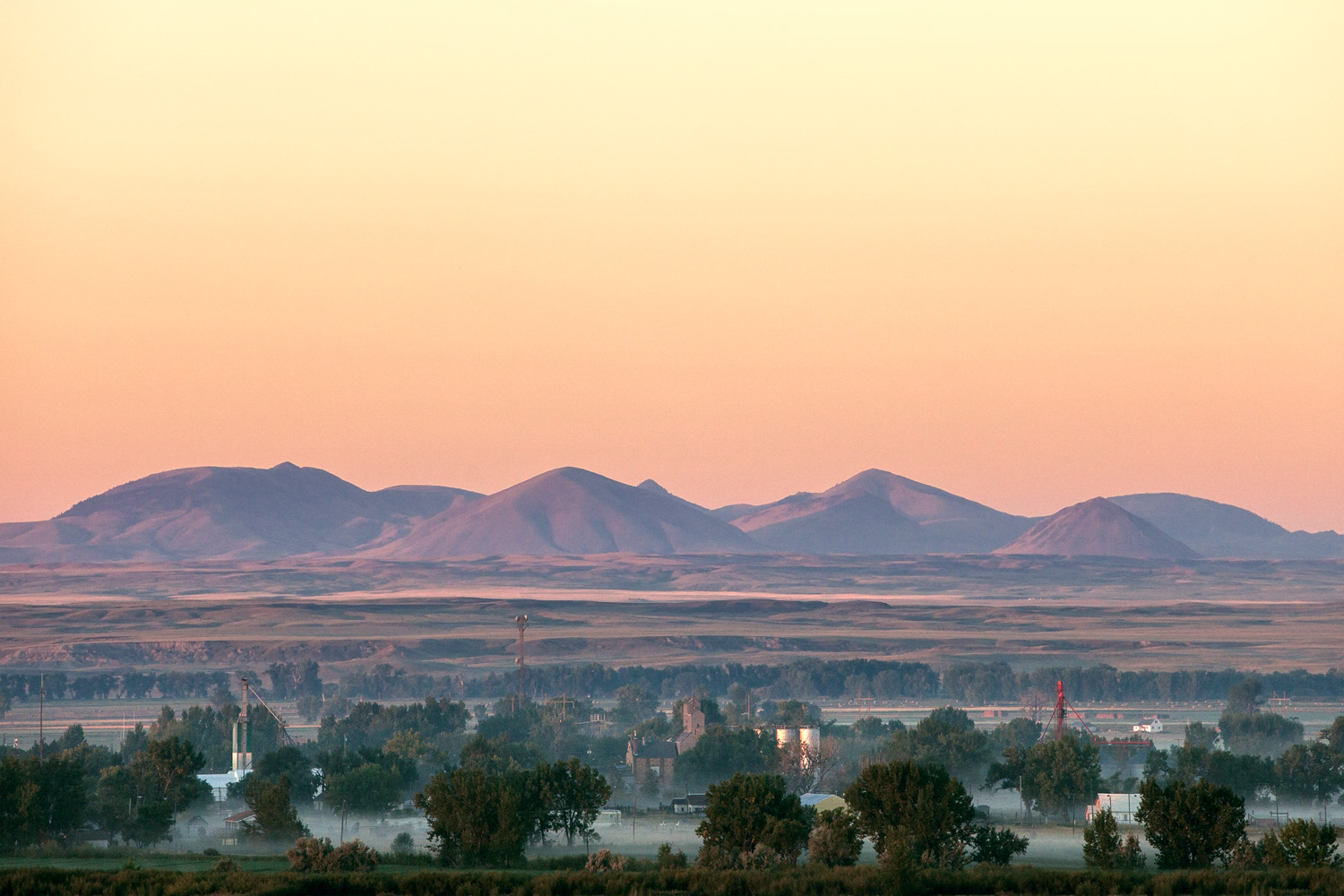 Fog drapes downtown Harlem, Montana with the Bear Paw Mountains looming large in the background.   → Buy a Print   or   License Photo