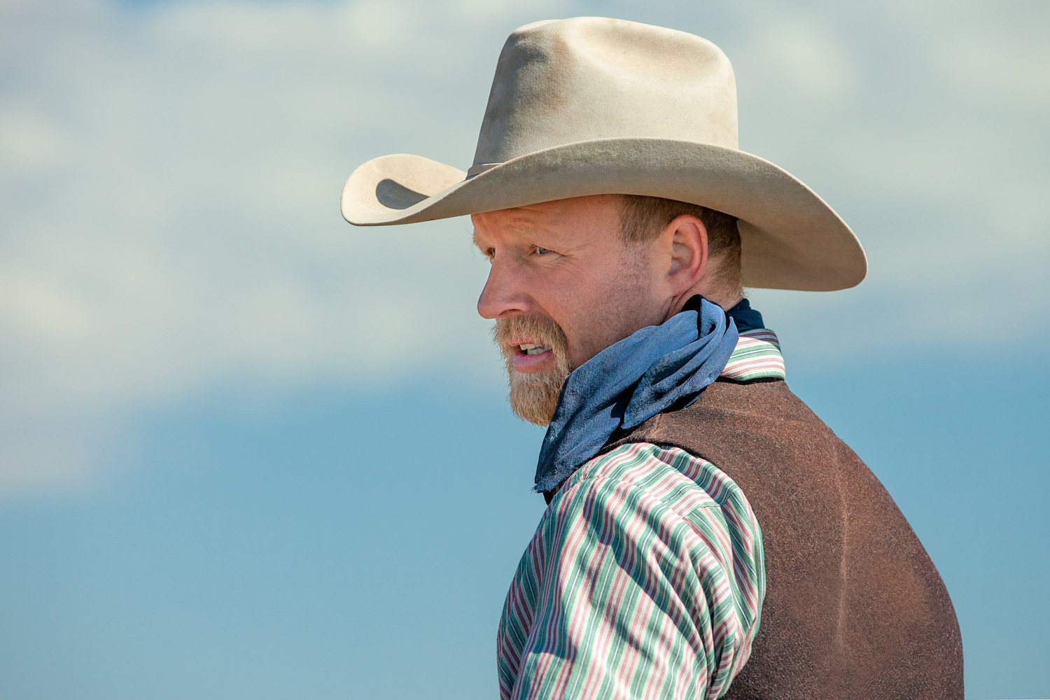A candid portrait of a real cowboy working on a ranch near Cleveland, Montana.  → License Photo