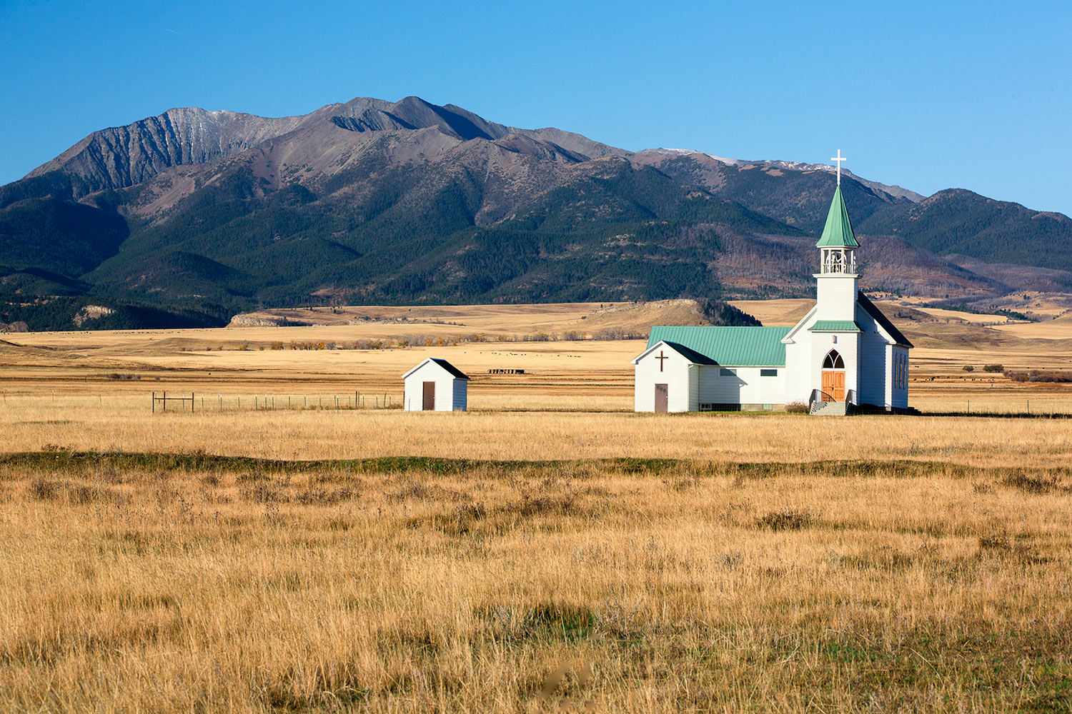 The rural Lutheran church in Melville, Montana is set against the Crazy Mountains.   → Buy a Print     or   License Photo
