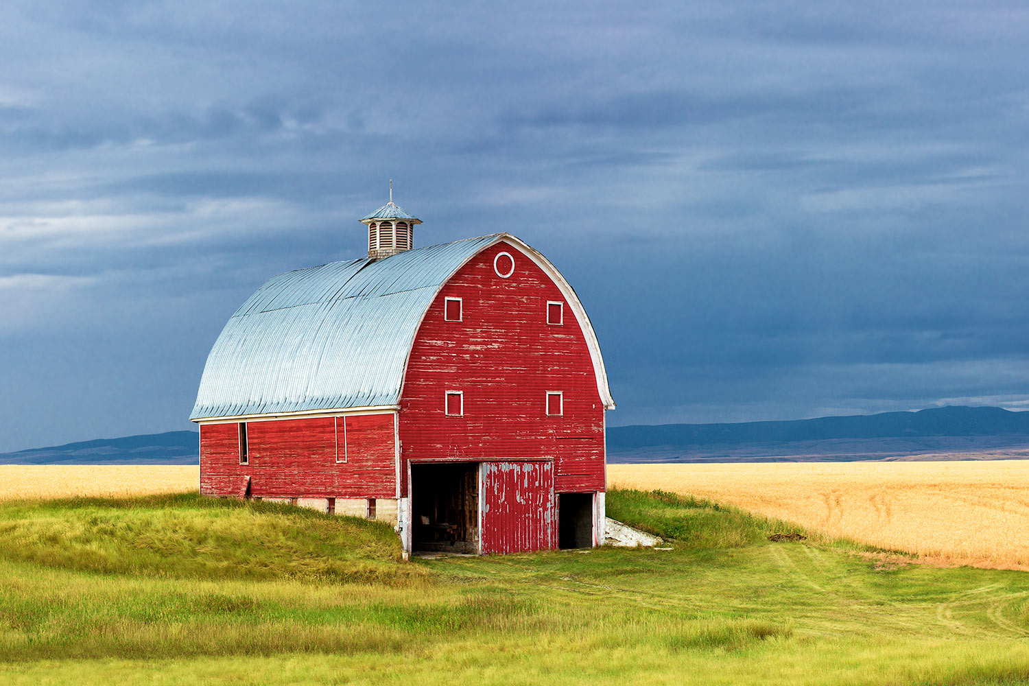 A red barn dots the landscape near Moore, Montana.   → Buy a Print     or   License Photo