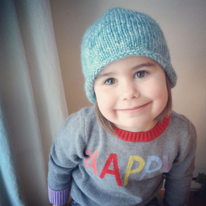Juliette, just-tured-four-year-old. In a  new knitted hat . iPhone (instagram) photo.