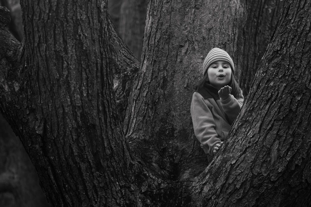 """she wanted a photo in """"her"""" tree. and then she posed herself. funny girl."""