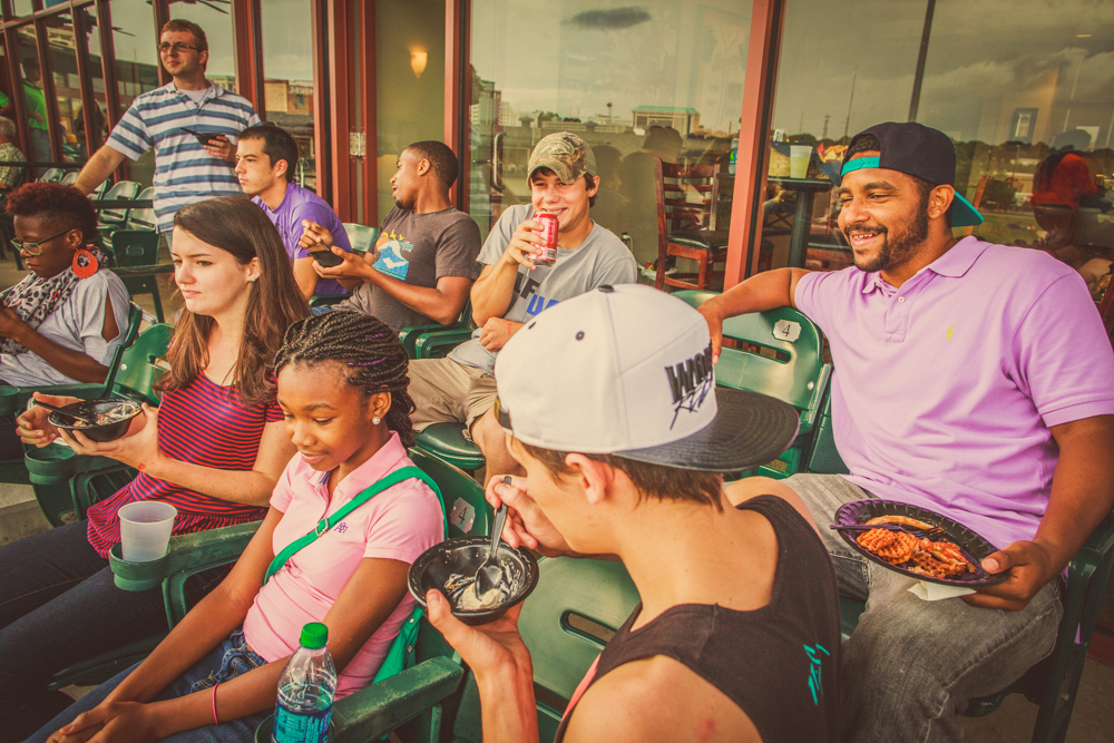 interns and staff at a montgomery biscuits baseball game.