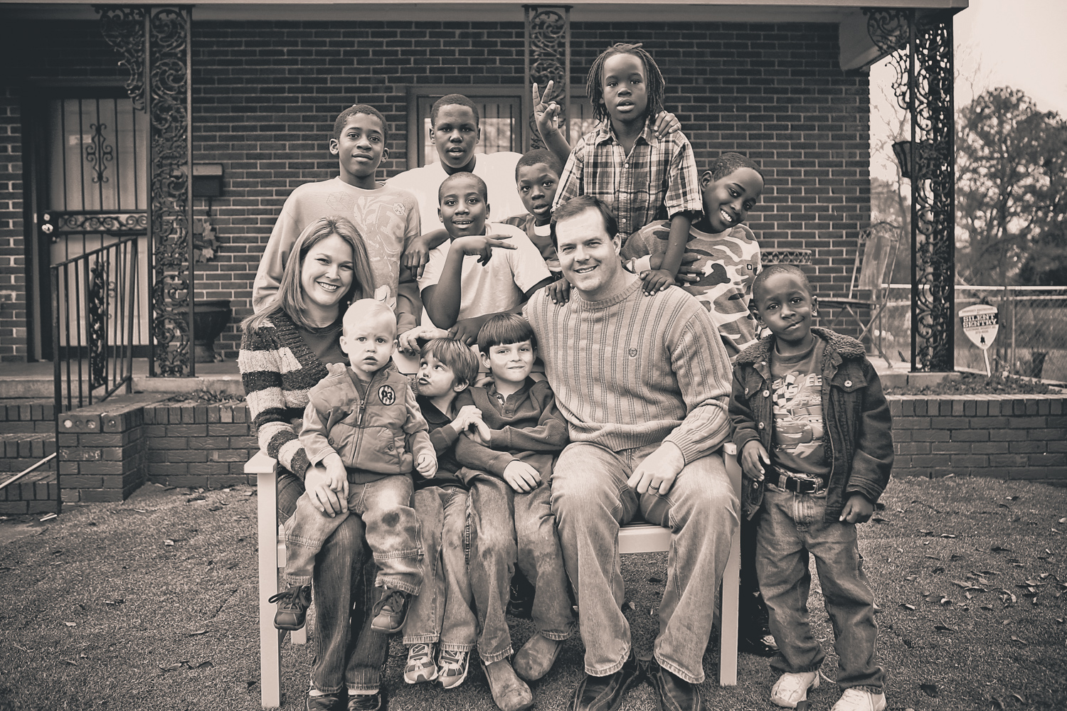 Founder Bryan Kelly and his wife, Delta, with their family and students from the neighborhood.