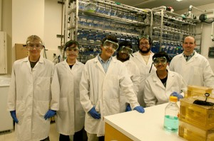 Students (from left) Ryan Quick (Hart High School), Rana Faraj (CSSM at John Hay), Andrew E. Megerian (University School), Jazmine C.D. Ellington (CSSM at John Hay) and Rohit Kumar (Shaker Heights High School) work closely in the lab with (back row, from left) Manuel Mendoza (CSSM at John Hay) and Brian McDermott (CWRU). Photography in the lab by Susan Griffith.