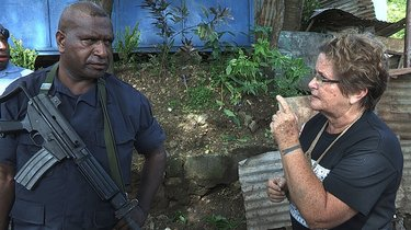 The Opposition   In a David and Goliath battle over land in Papua New Guinea, Joe Moses, leader of the Paga Hill settlement, must save his 3000 people before they are evicted to an industrial waste site.