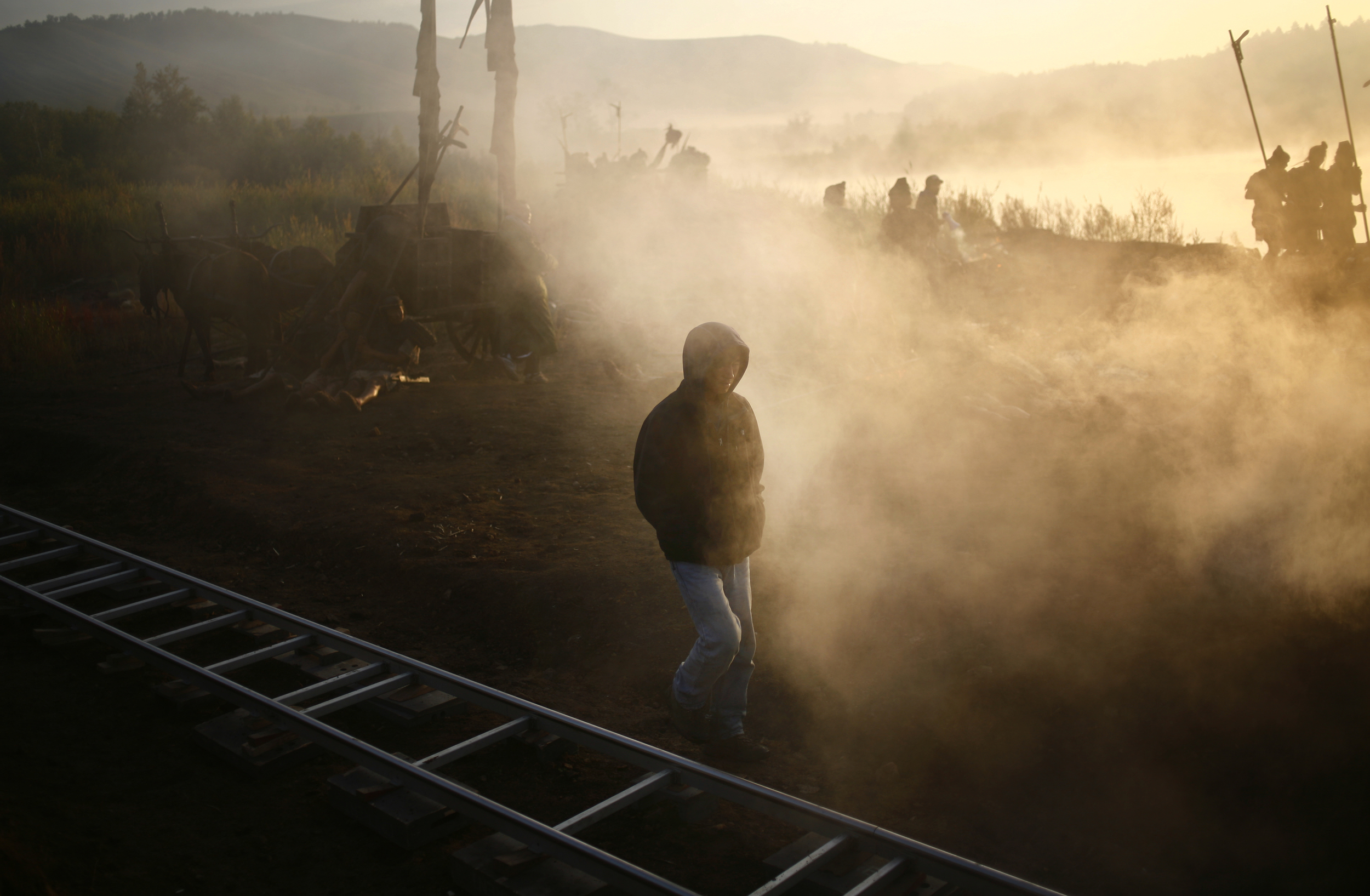 ​A crew member of a Chinese movie set walks down an on-location set in the early morning.