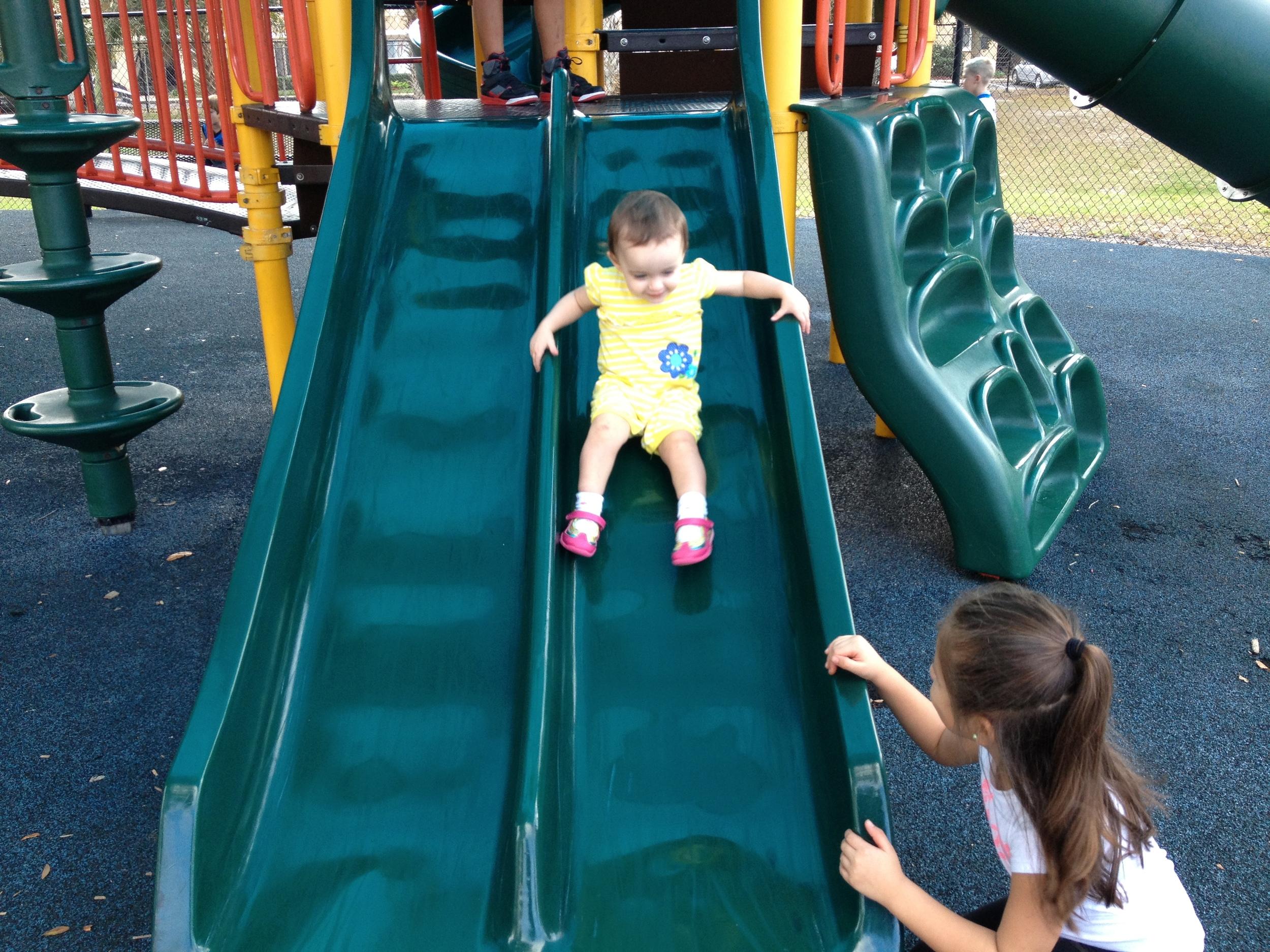 Maya helps D down the slide