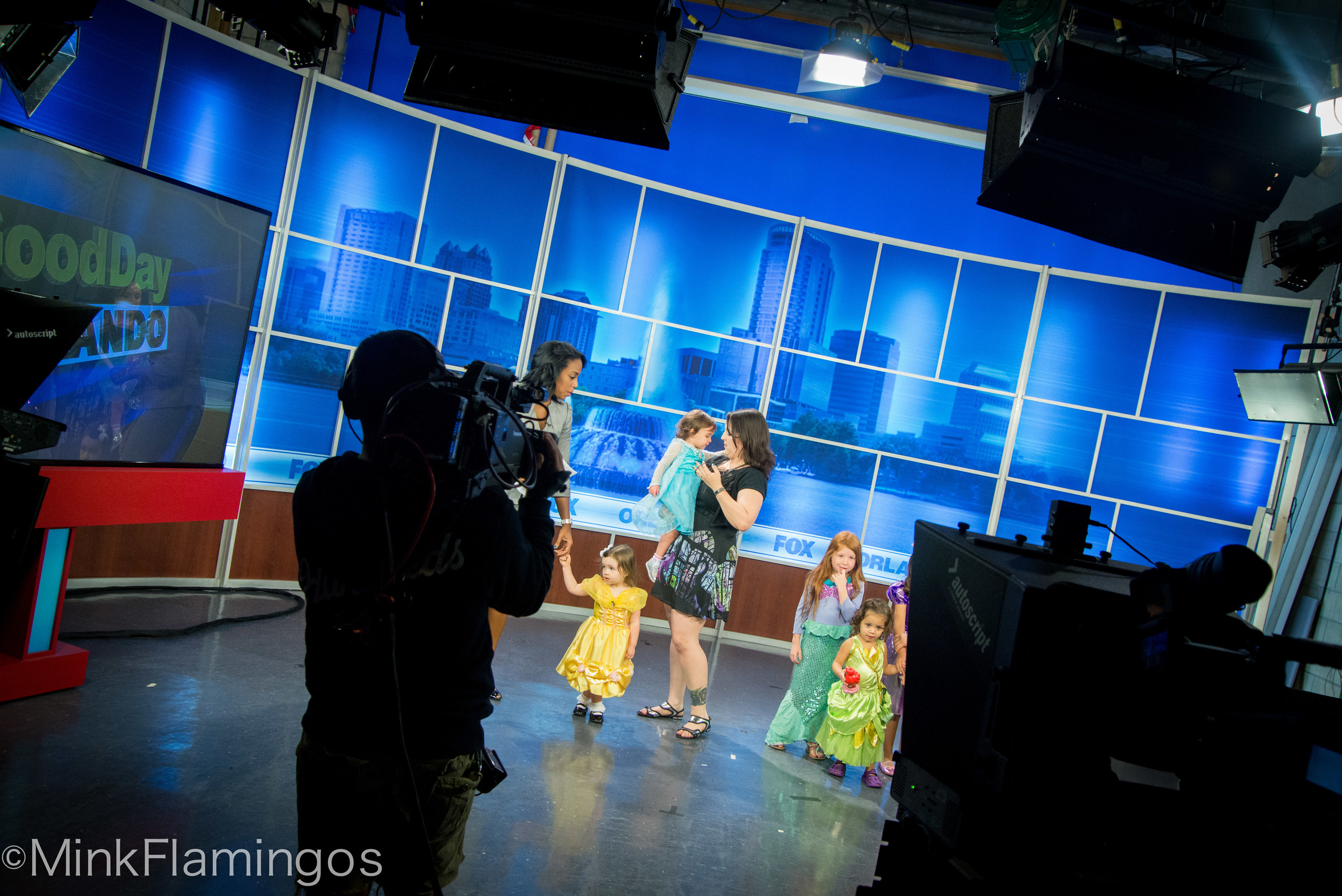 Me, on TV, talking about Disney Heroines, wearing a dress covered in Maleficent's glorious visage