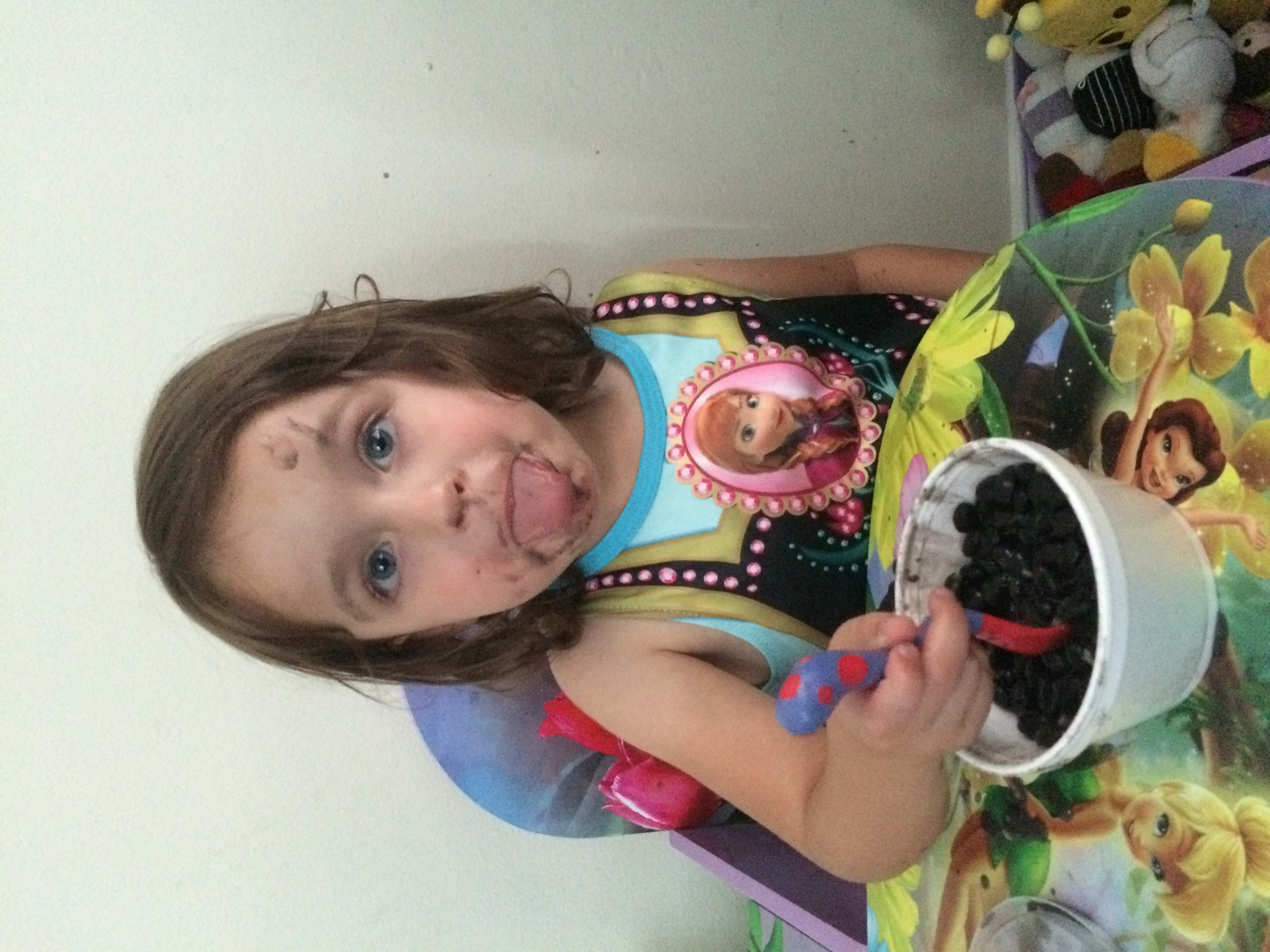 This picture doesn't allow you to appreciate the splattered black beans all over the wall behind her