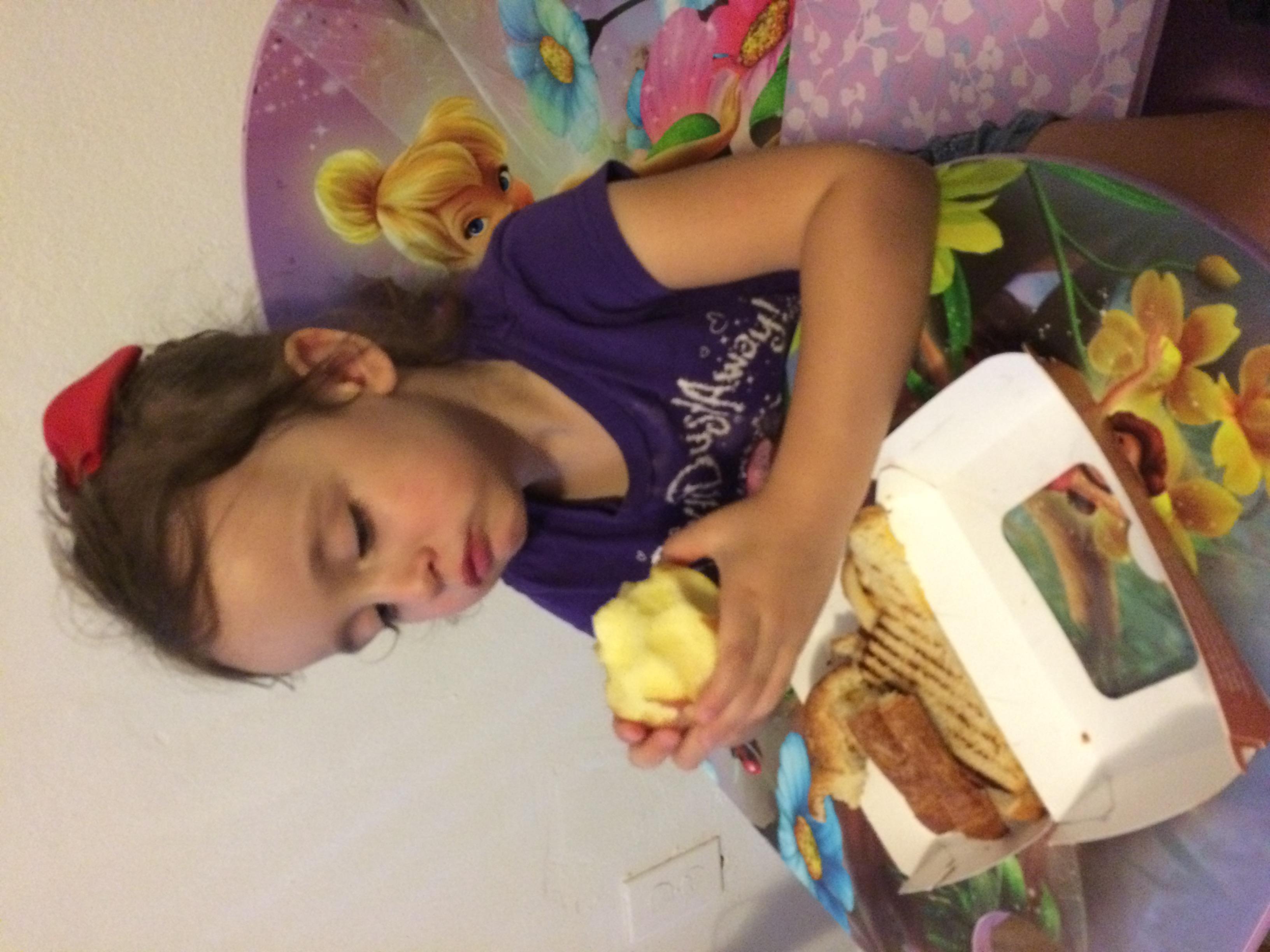 Daphne regarding her apple suspiciously