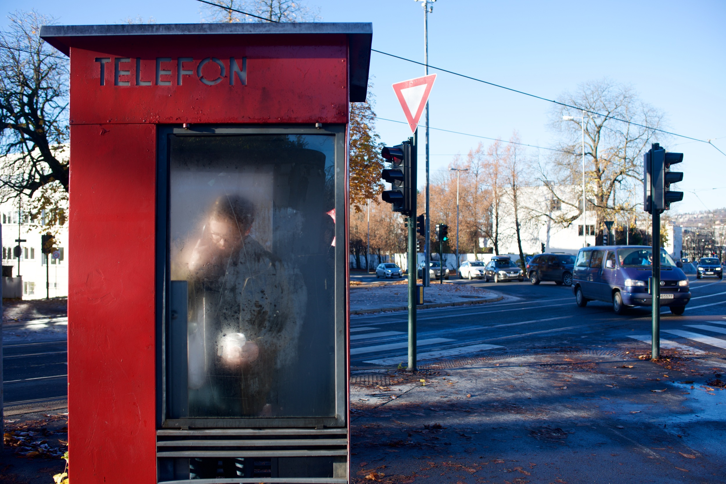 Matt makes a business call on one of Oslo's inexplicable pay phones.