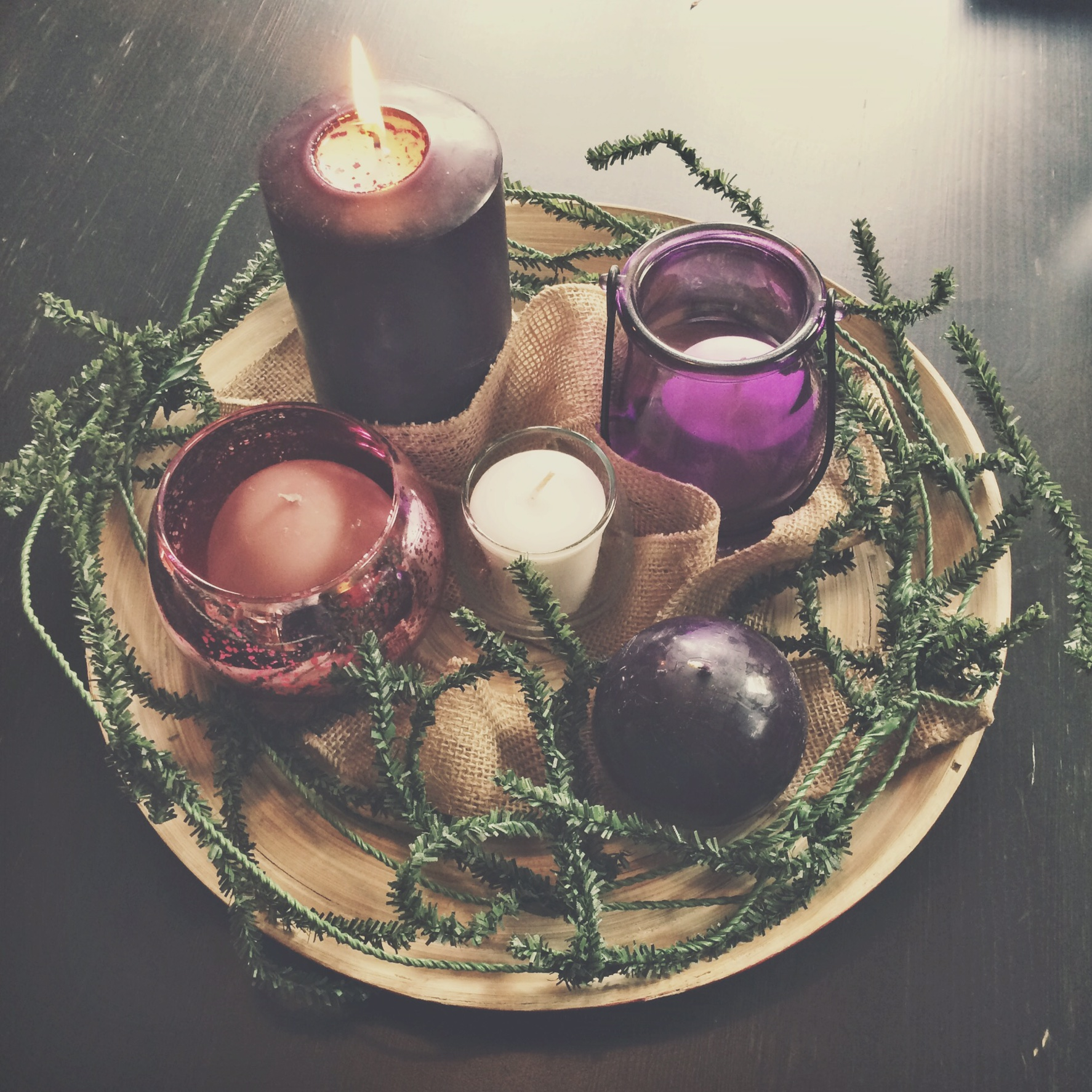 An Advent wreath I put together for our community this year––one of my favorite symbols of the season, layered with meaning. In the shape of a circle to symbolize the eternal nature of God, in Whom there is no beginning nor end. Green to symbolize everlasting life and the exhaustless mercy of God. 3 purple candles that mark the weeks of fasting, mourning, waiting, longing. The 1 pink candle that marks our shift to rejoicing and celebrating the birth of the incarnate God. And finally, the 1white candle in the center, the Christ candle, symbolizing the perfection and completion that is embodied in Jesus.