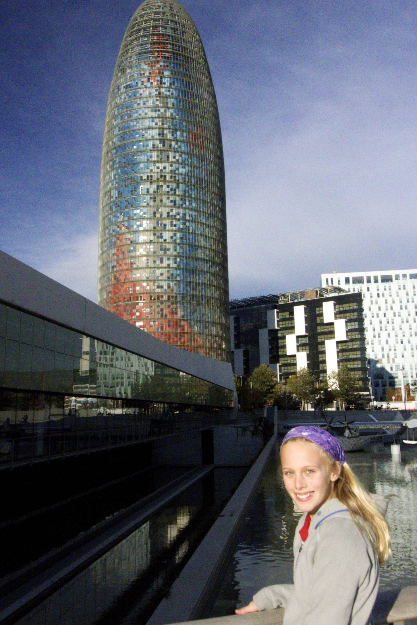 Zoe outside the Museum of Design in Barcelona with the Torre Agbar in the background.