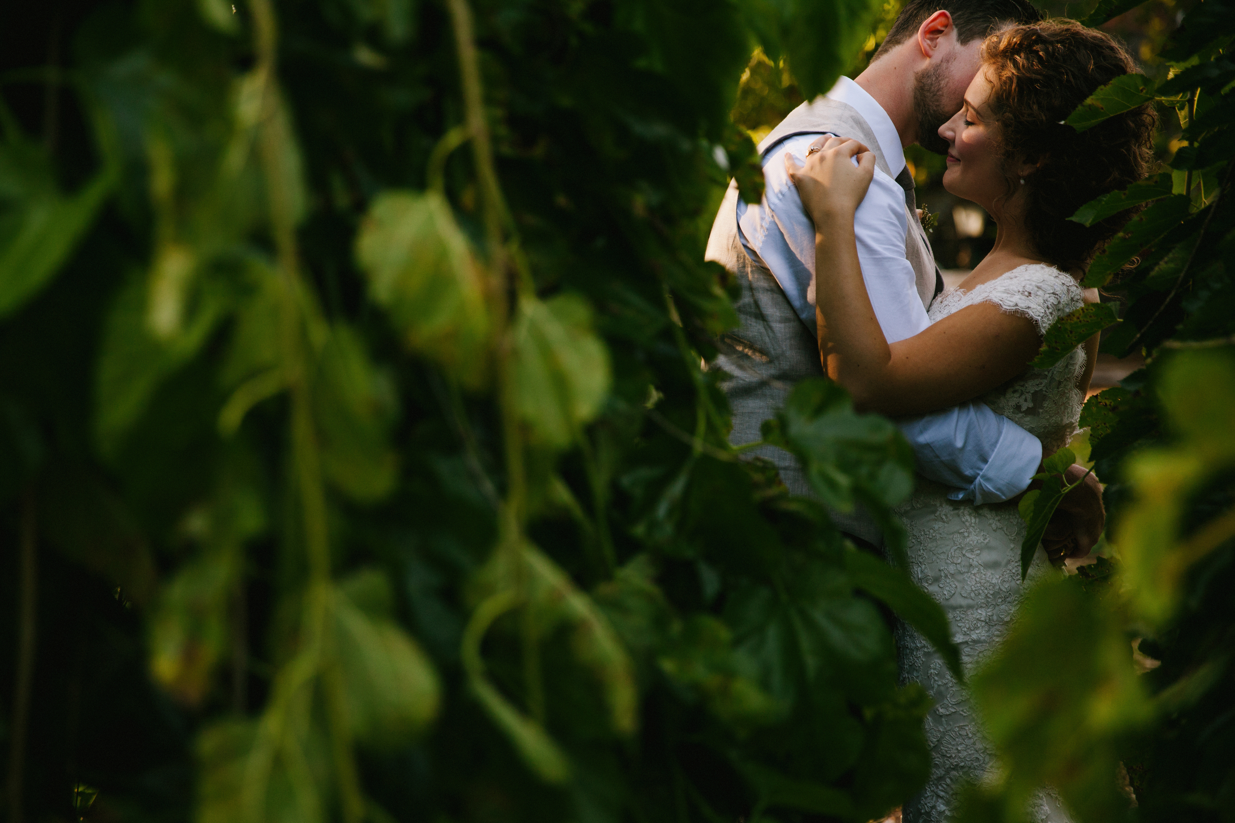 Bride and groom embrace at this Prince Edward County Wedding