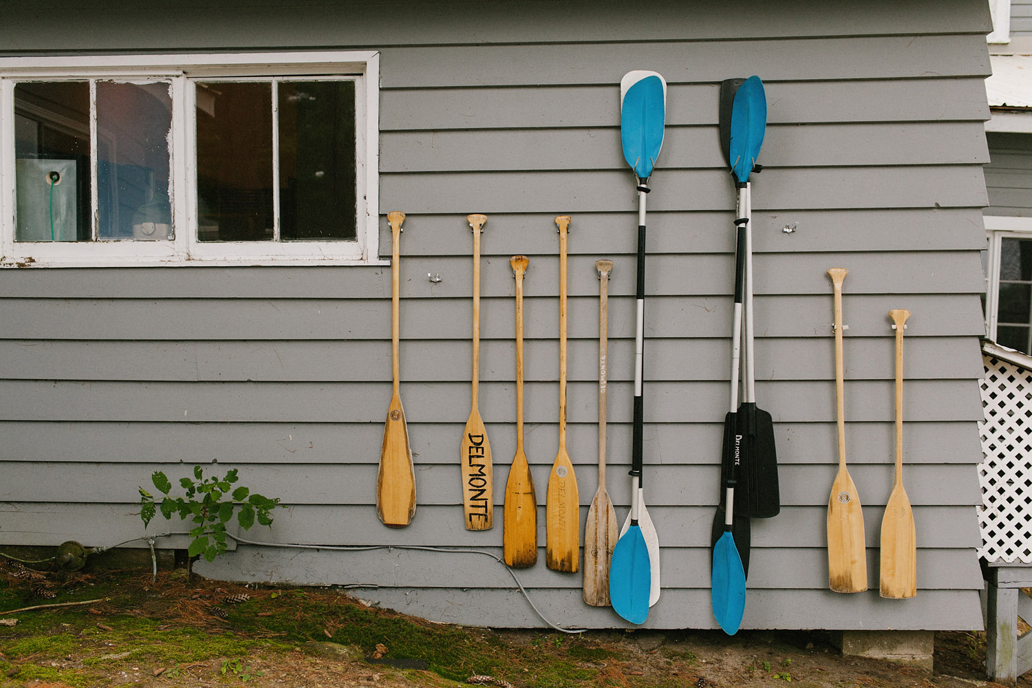 paddles on the wall at Delmonte in the Pines during a wedding