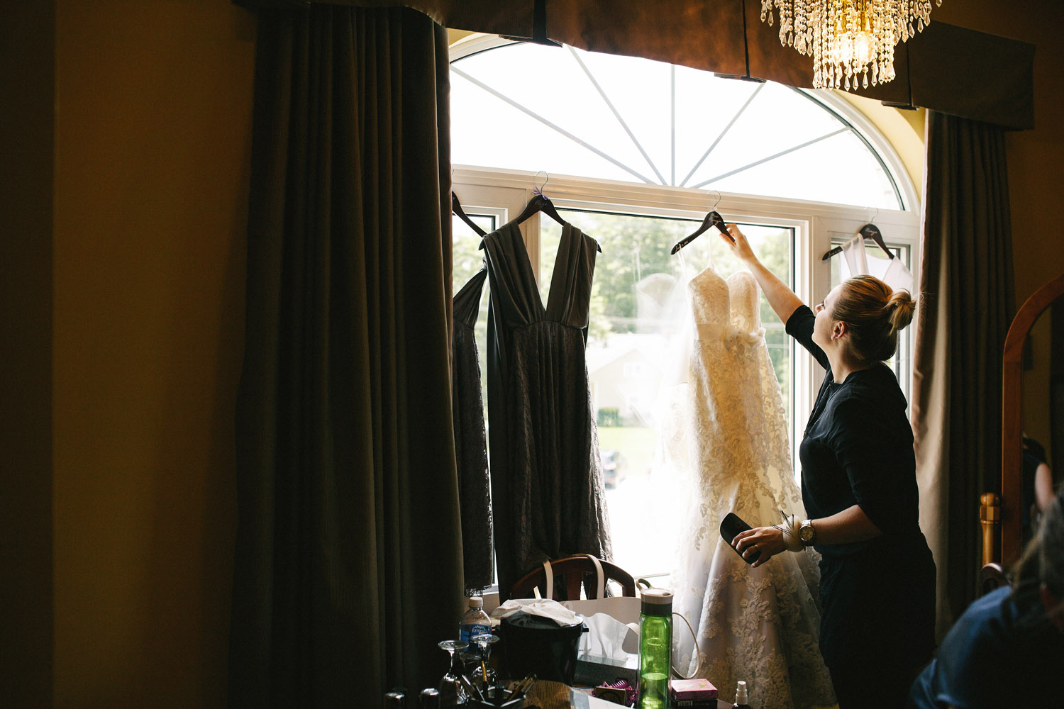 Placing wedding dress in the window at Walters Falls Inn