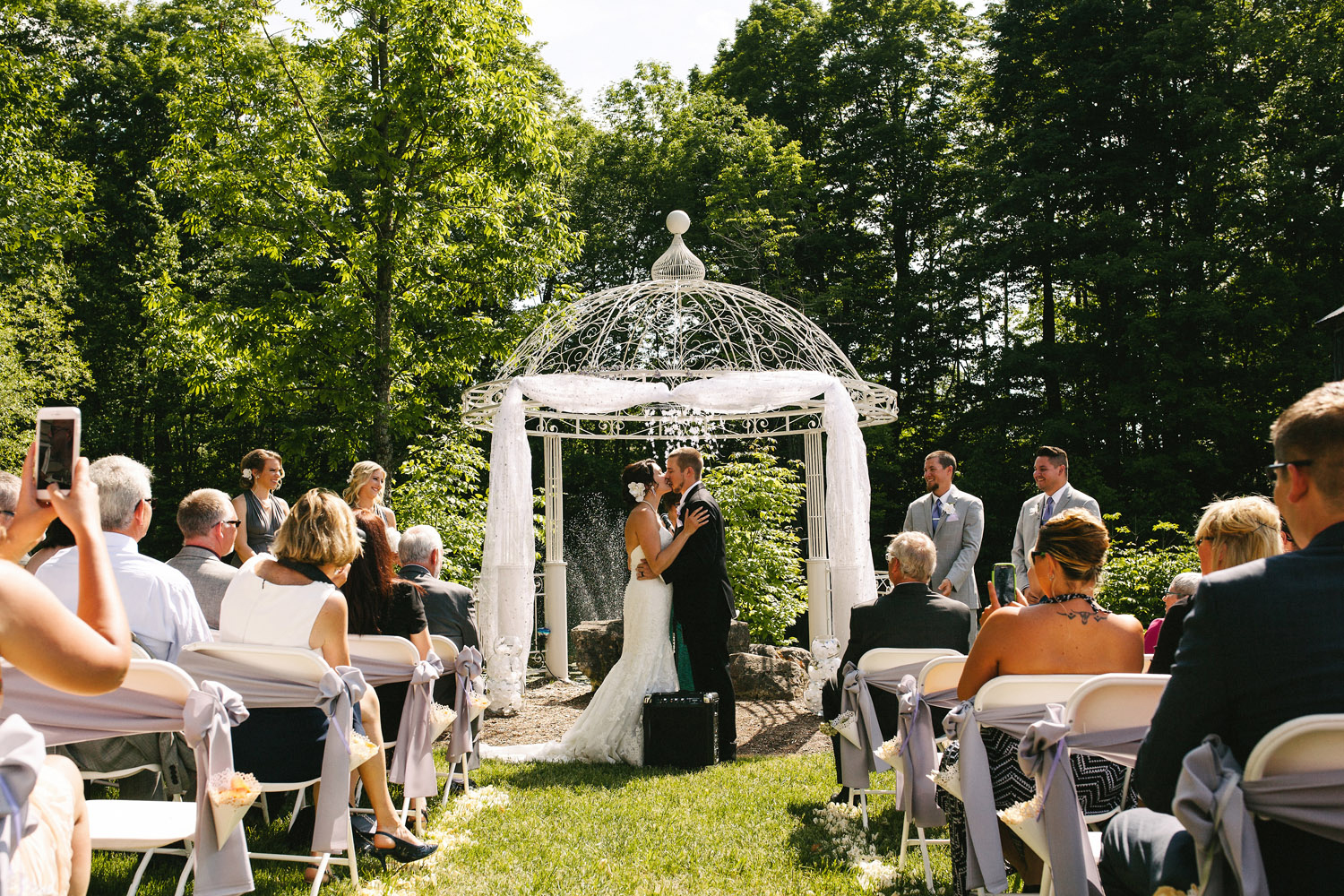First kiss at outdoor wedding at Walters Falls Inn