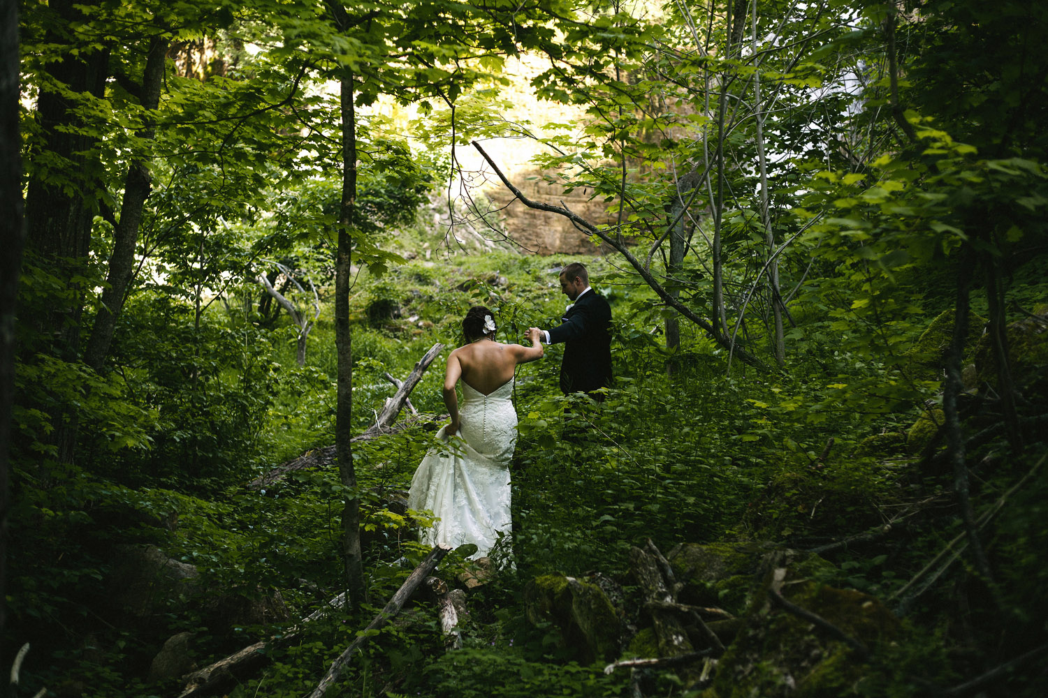 Bride and Groom adventure to waterfall at Walters Falls Inn