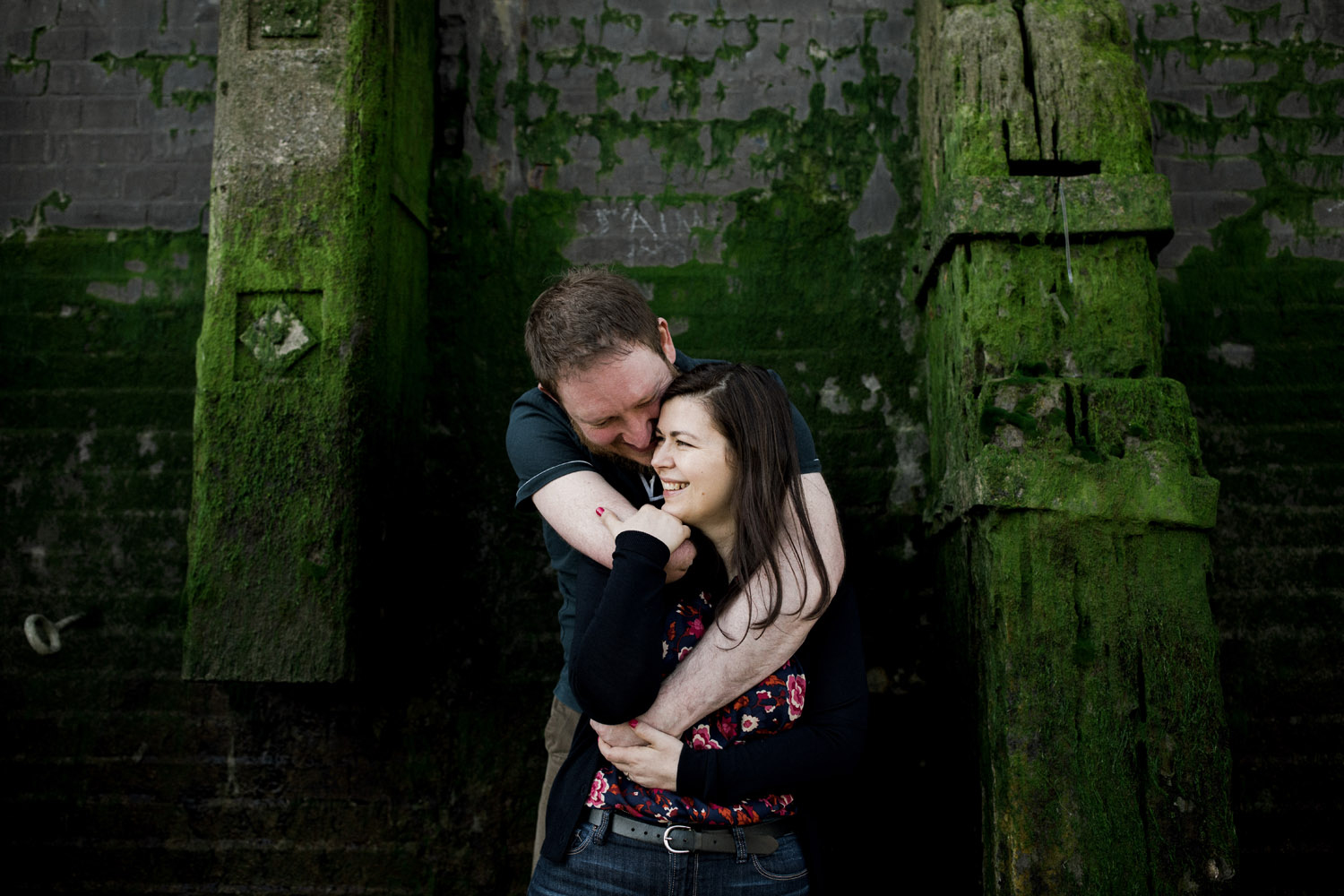 Couple cuddles near river Thames